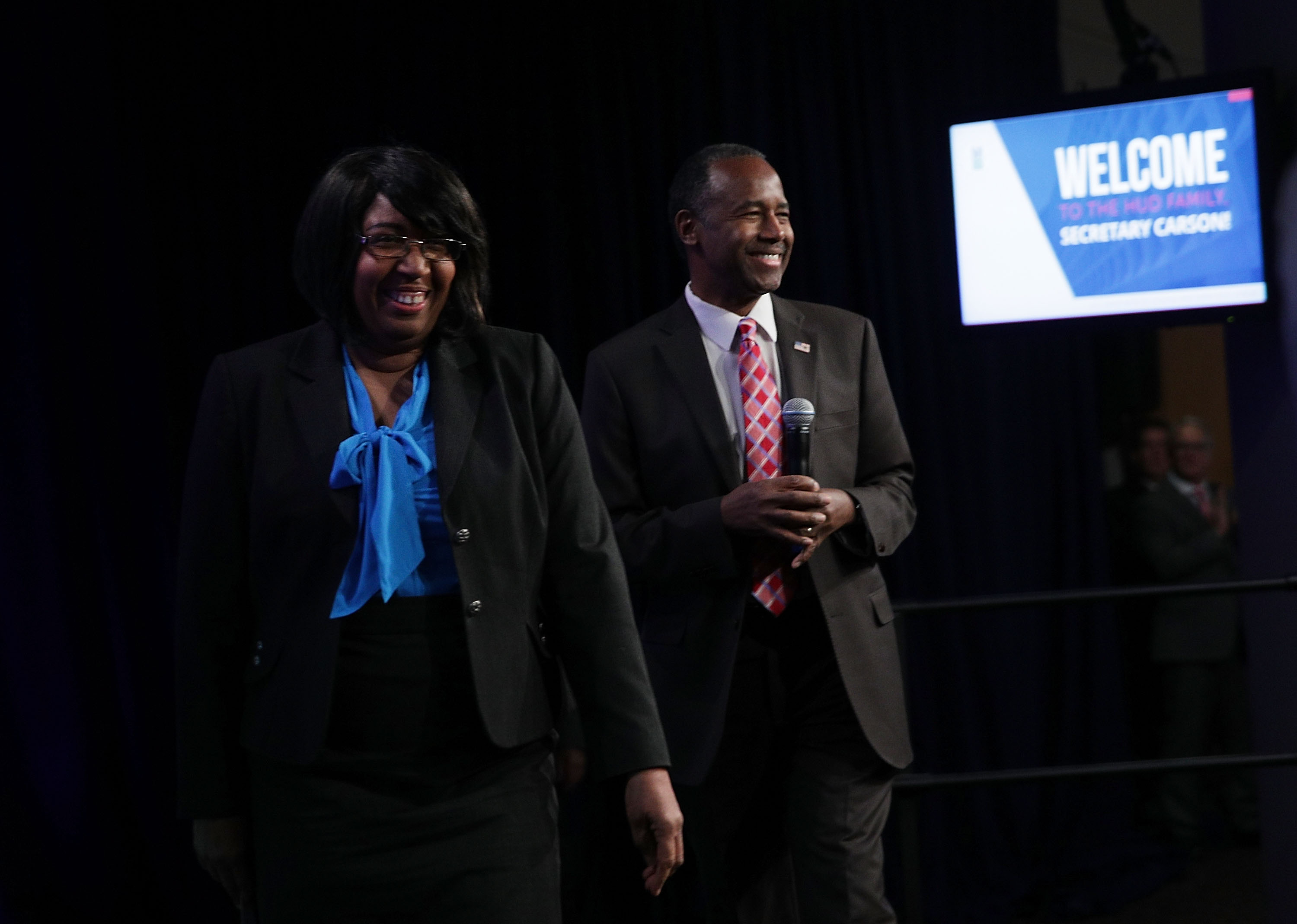 U.S. Housing and Urban Development (HUD) Secretary Ben Carson and his wife Candy Carson walk on stage prior to his address to his employees March 6, 2017 in Washington, DC.