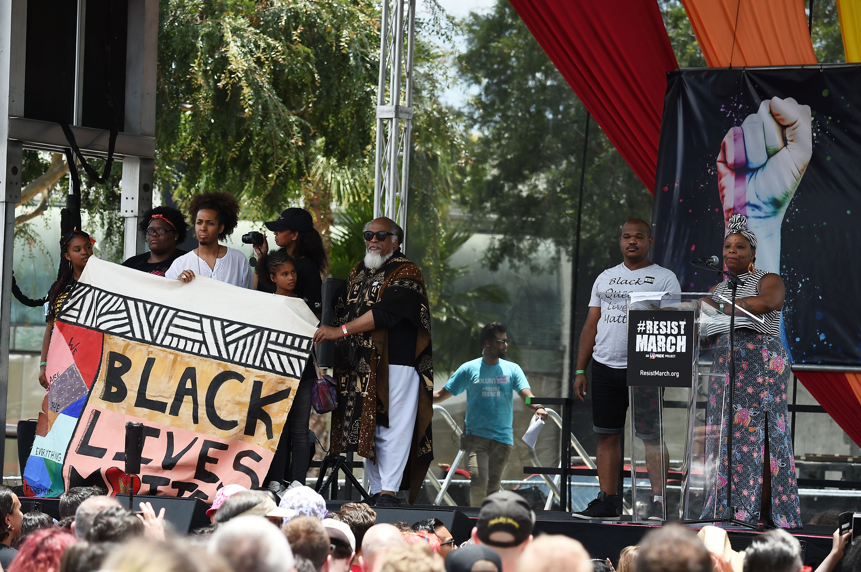 Activists Christopher Jackson (L) and Patrisse Cullors (R) attend the LA Pride #ResistMarch on June 11, 2017 in West Hollywood, California.