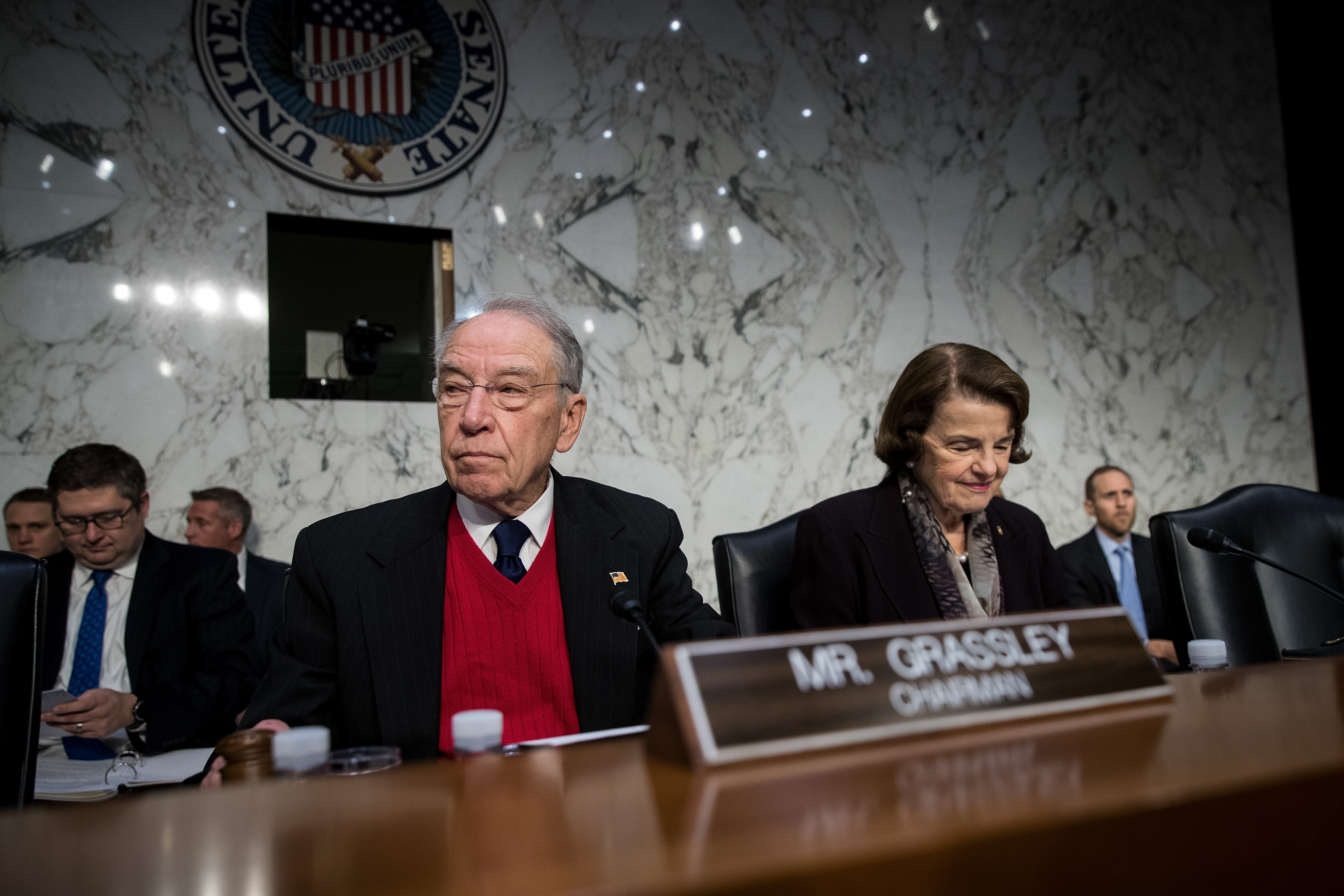 Committee chairman Sen. Chuck Grassley (R-IA) and ranking member Sen. Dianne Feinstein (D-CA) arrive for a Senate Judiciary Committee hearing on Capitol Hill, December 6, 2017 in Washington, DC.