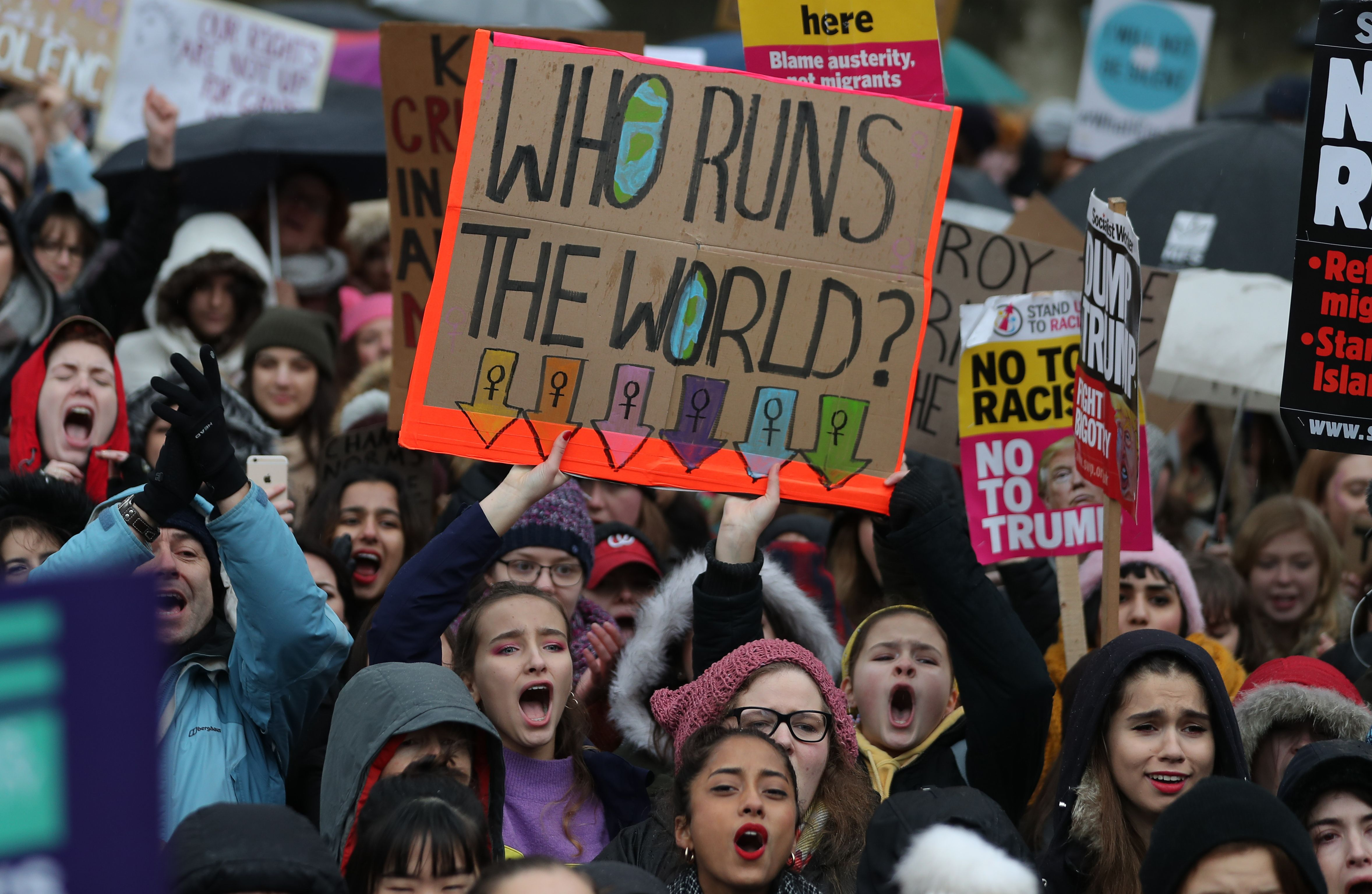 Protesters hold up placards during the Women's March in London on Jan. 21, 2018 as part of a global day of protests, a year to the day since Donald Trump took office as U.S. president.