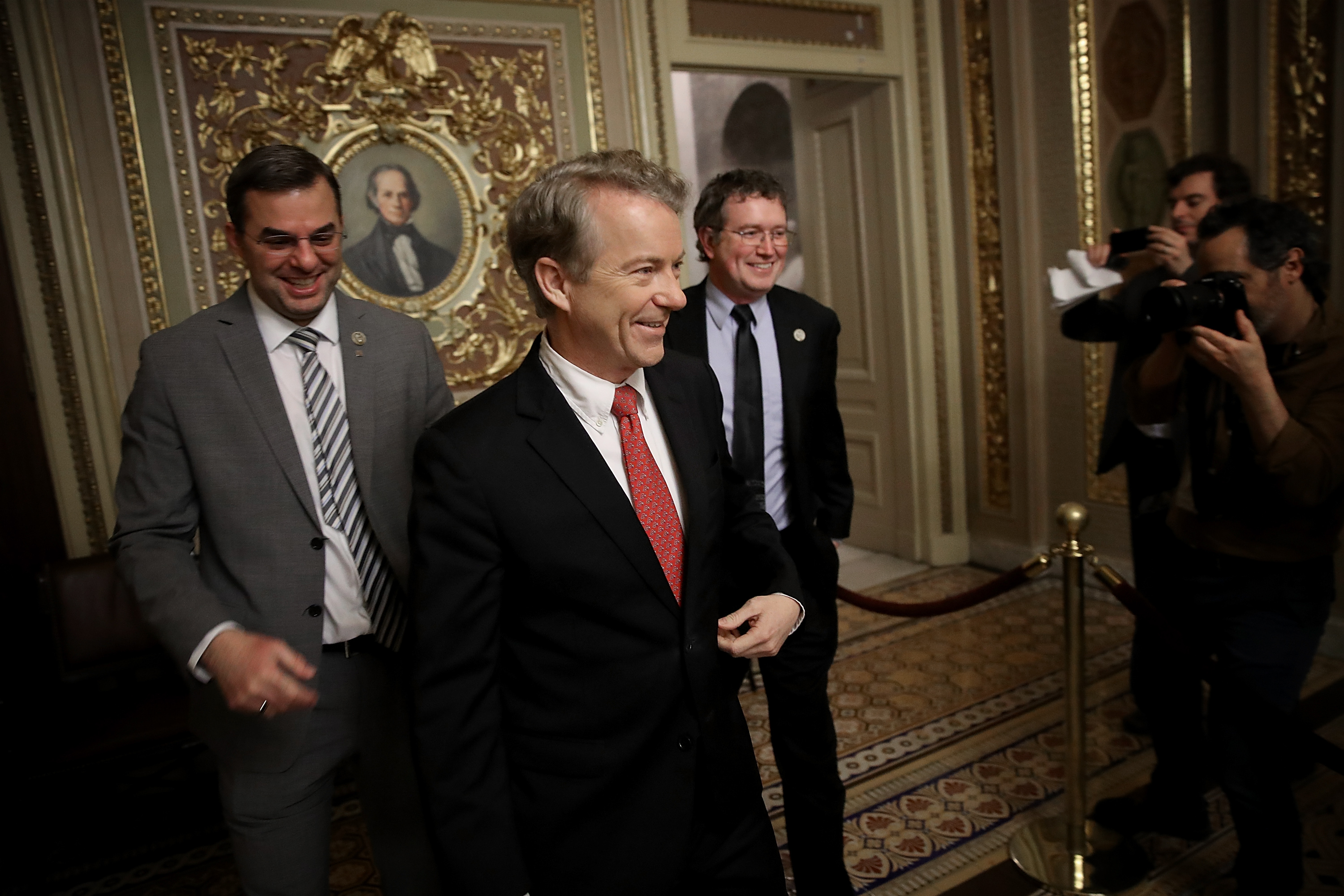 Sen. Rand Paul takes a break from the floor of the U.S. Senate with Rep. Justin Amash and Rep. Thomas Massie at the U.S. Capitol on Feb. 8, 2018.