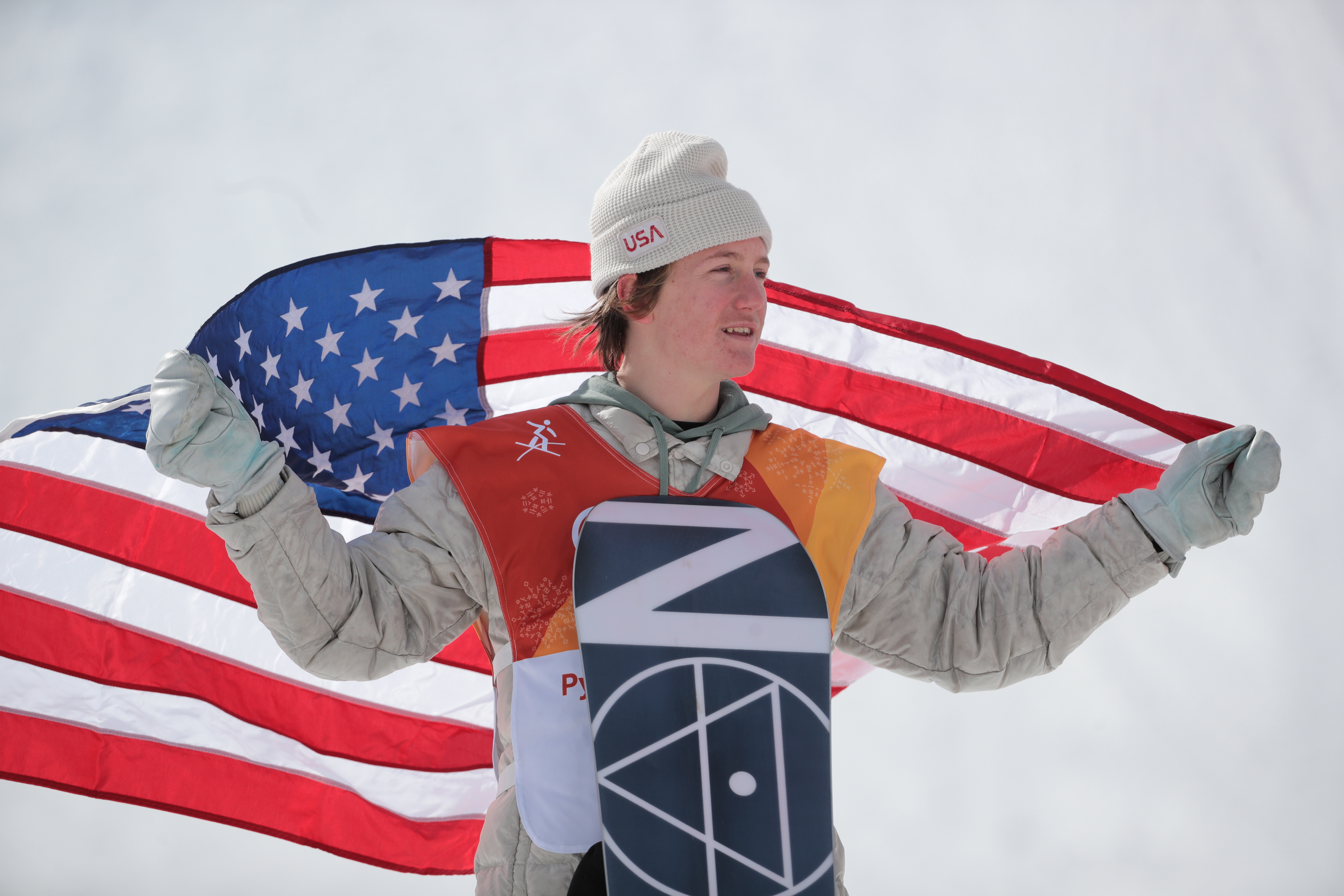 PYEONGCHANG, SOUTH KOREA  FEBRUARY 11, 2018: First-placed Redmond Gerard of the United States waves a US national flag at a flower ceremony for the men's snowboarding slopestyle event at the 2018 Winter Olympic Games, at the Phoenix Snow Park. Sergei Bobylev/TASS (Photo by Sergei BobylevTASS via Getty Images)