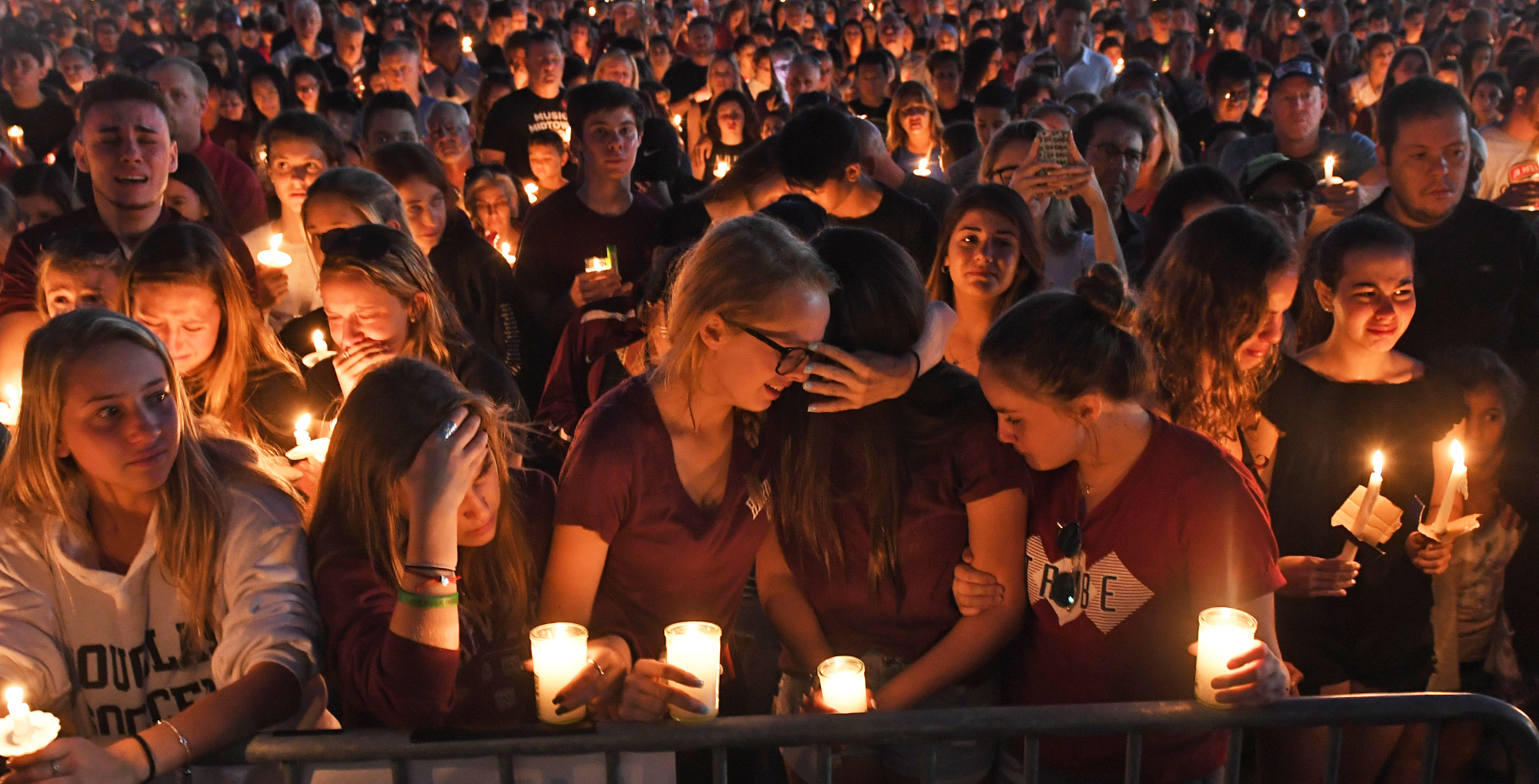 Mourners gather at a vigil for the victims of the mass shooting at Marjory Stoneman Douglas High School in Parkland, Fla., on Feb. 15, 2018.
