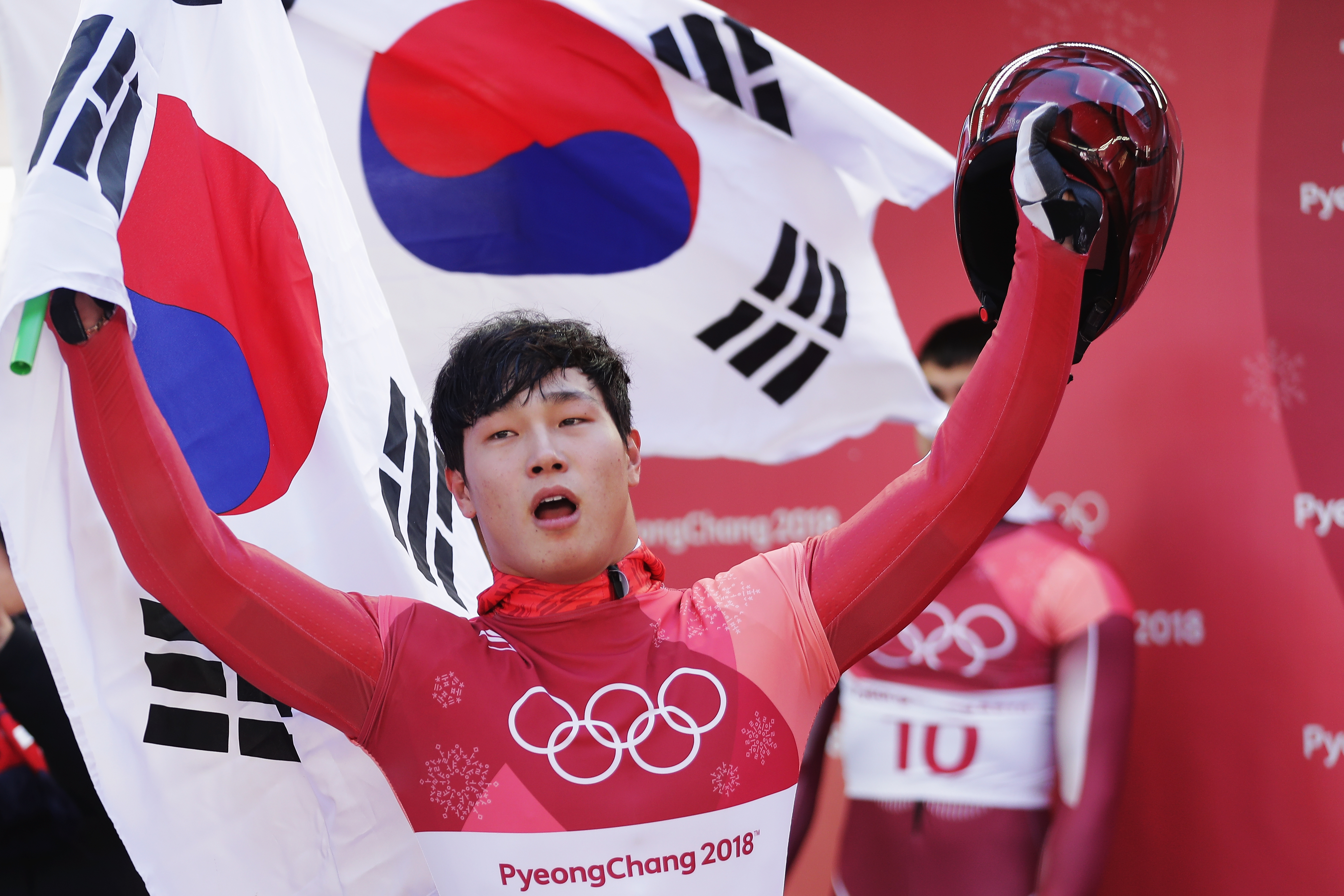 Sungbin Yun of Korea celebrates winning the Men's Skeleton in Pyeongchang, South Koreaon Feb. 16, 2018.
