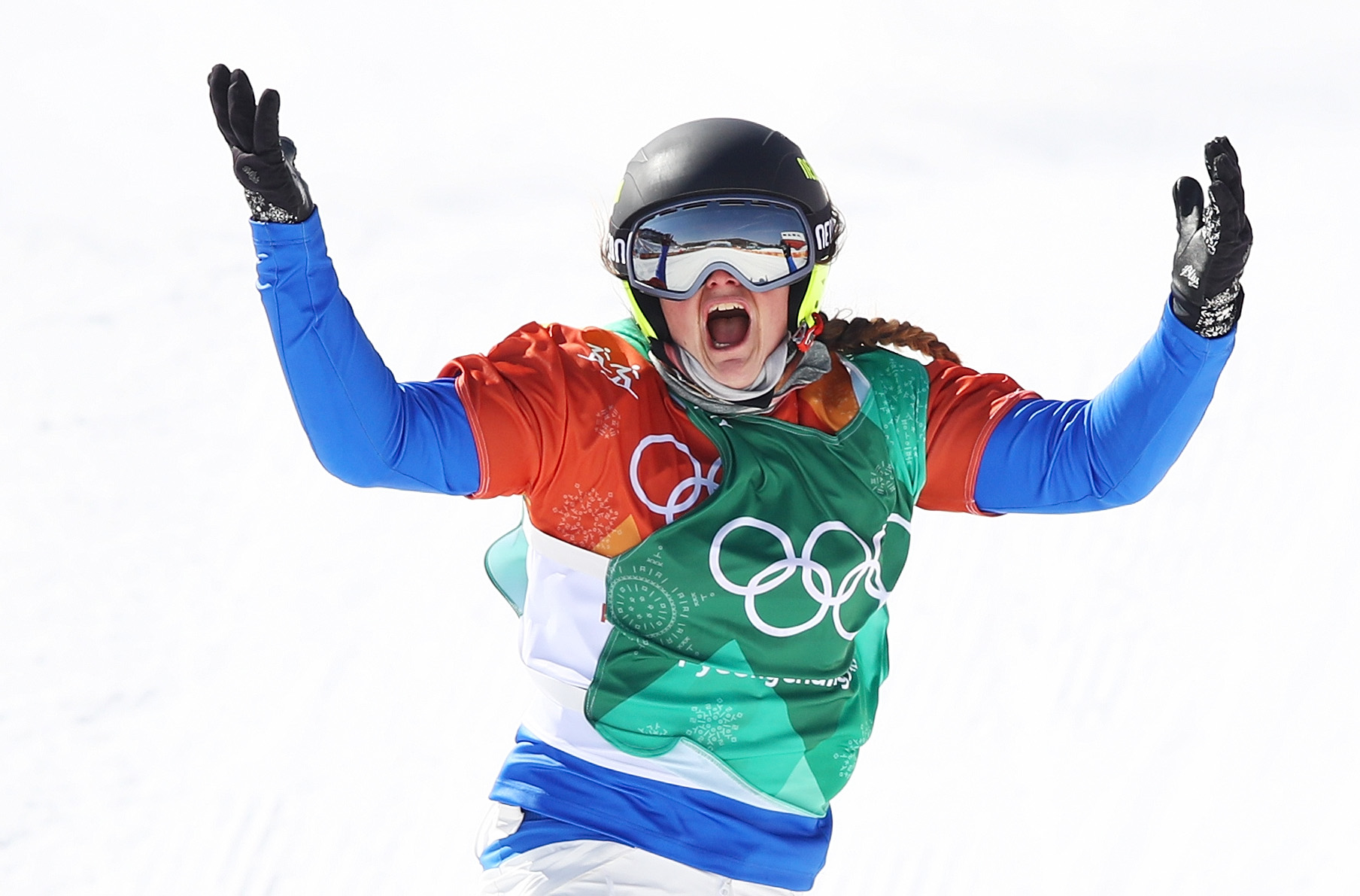 Michela Moioli of Italy celebrates winning gold in the Ladies' Snowboard Cross gold medal at the PyeongChang 2018 Winter Olympic Games on Feb. 16, 2018.