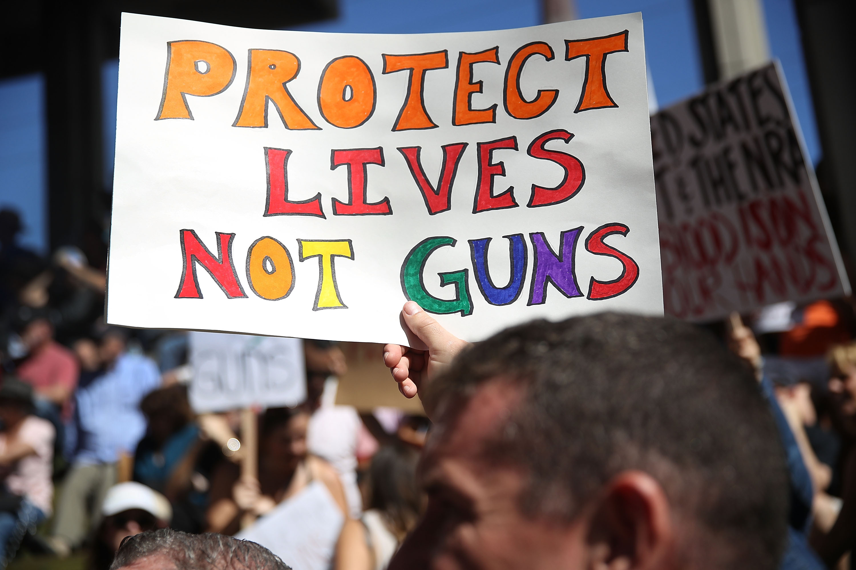 People join together after a school shooting that killed 17 to protest against guns on the steps of the Broward County Federal courthouse on February 17, 2018 in Fort Lauderdale, Florida. Earlier this week former student Nikolas Cruz opened fire with a AR-15 rifle at the Marjory Stoneman Douglas High School killing 17 people.  (Photo by Joe Raedle/Getty Images)