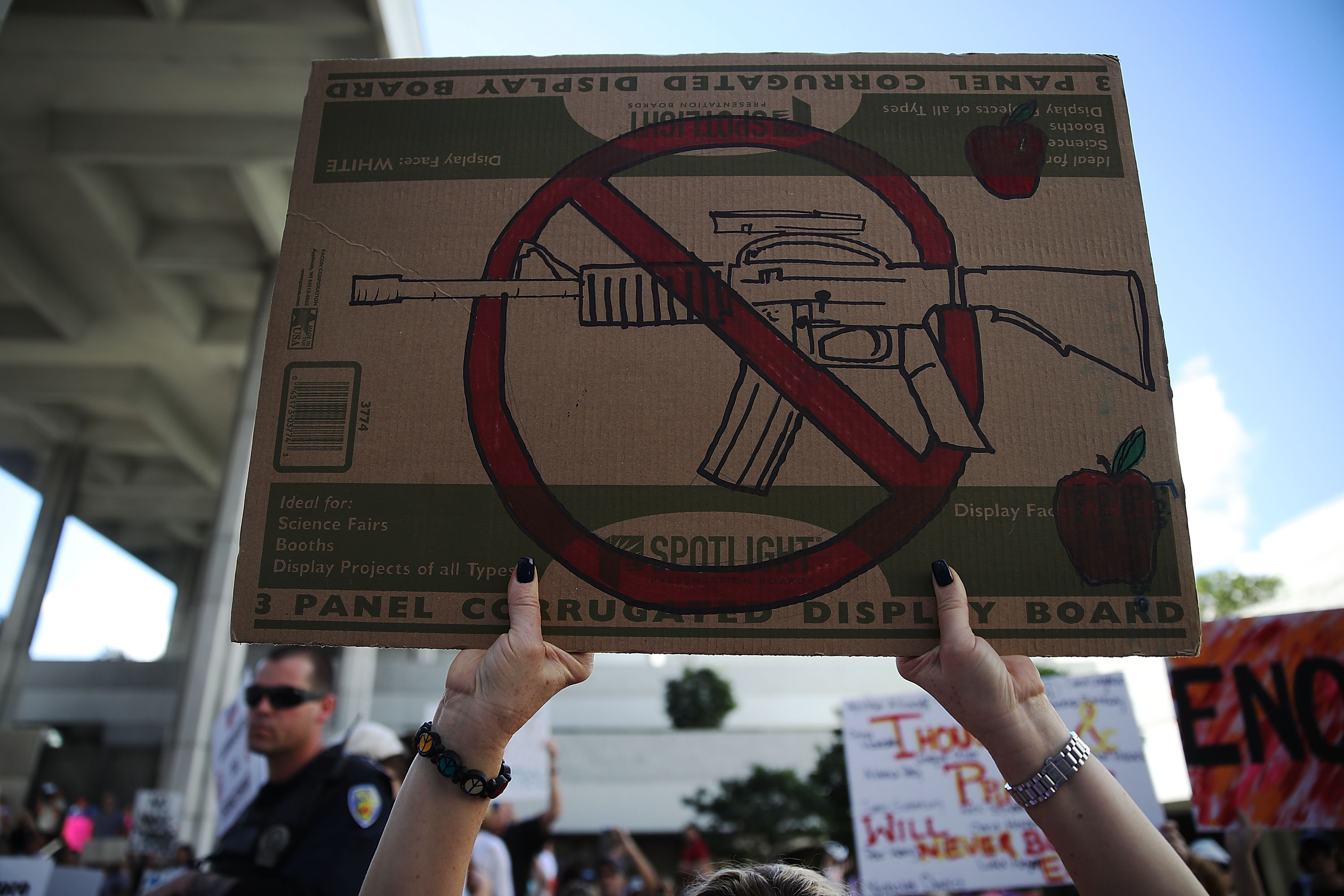 People join together after a school shooting that killed 17 to protest against guns on the steps of the Broward County Federal courthouse on February 17, 2018 in Fort Lauderdale, Florida.