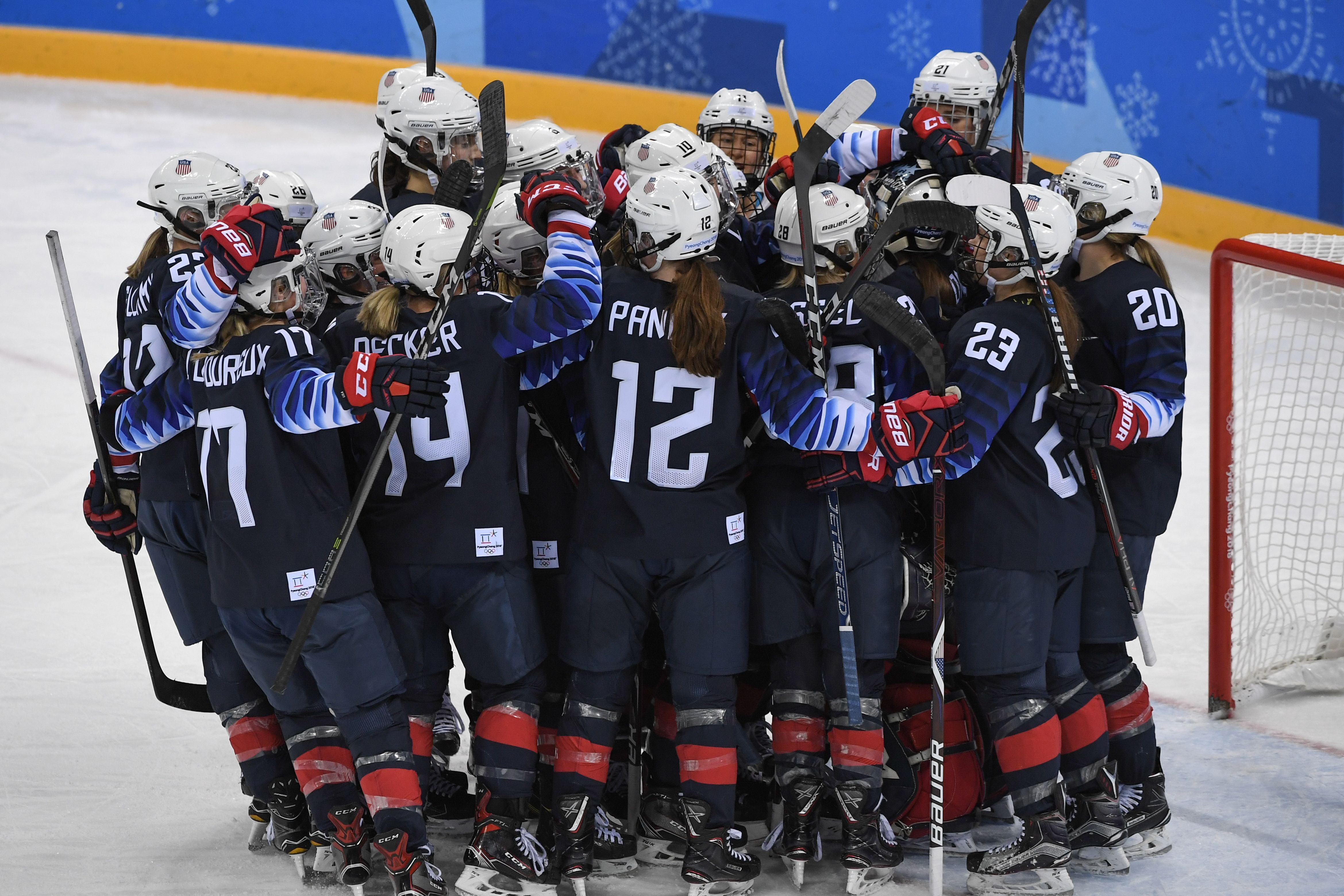 U.S. players celebrate after the women's ice hockey semifinal game between the United States and Finland during the Pyeongchang 2018 Winter Olympic Games at the Gangneung Hockey Centre in Gangneung on Feb. 19, 2018.