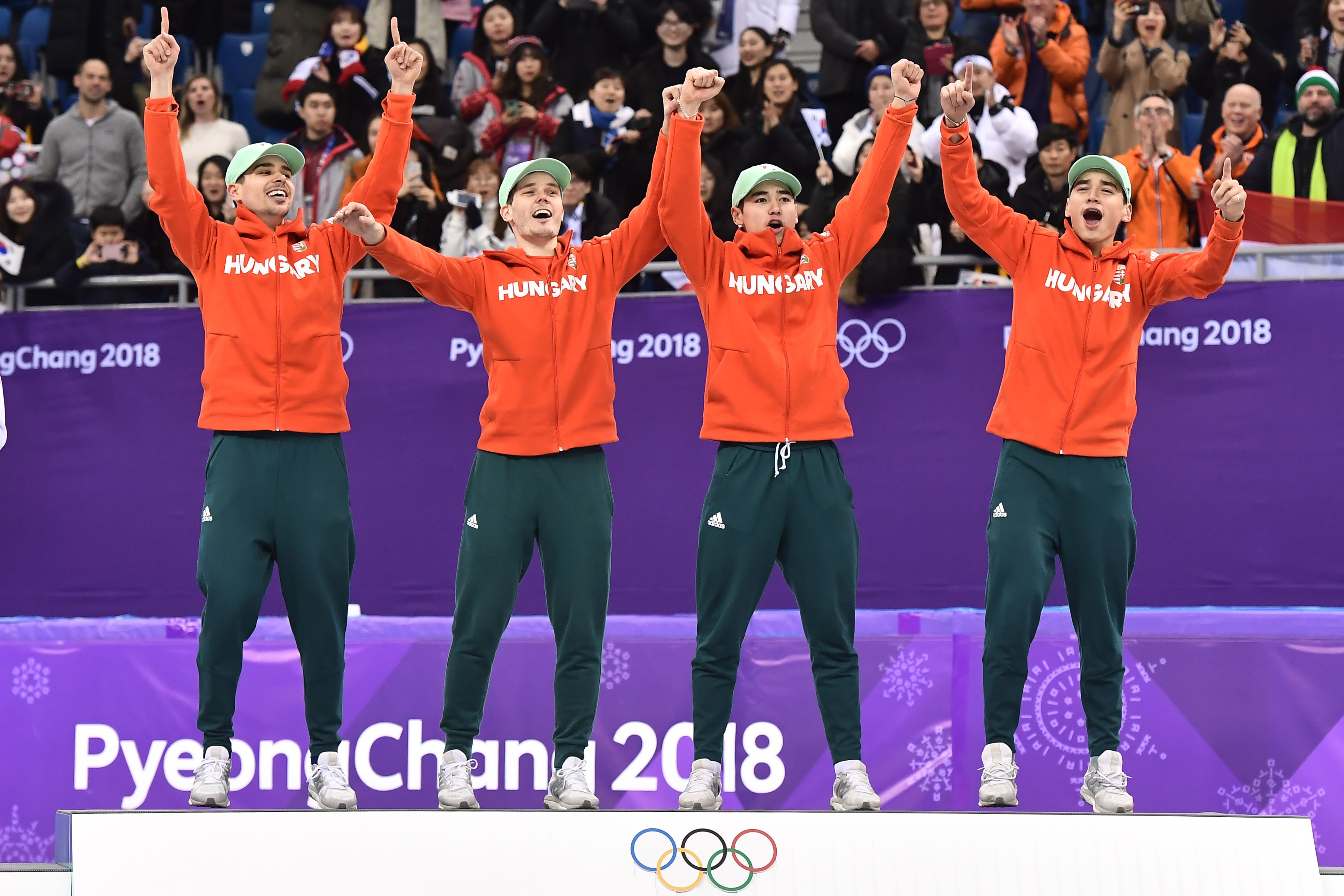 Team Hungary celebrate their gold win on the podium in the men's 5,000m relay short track speed skating on Feb. 22, 2018.