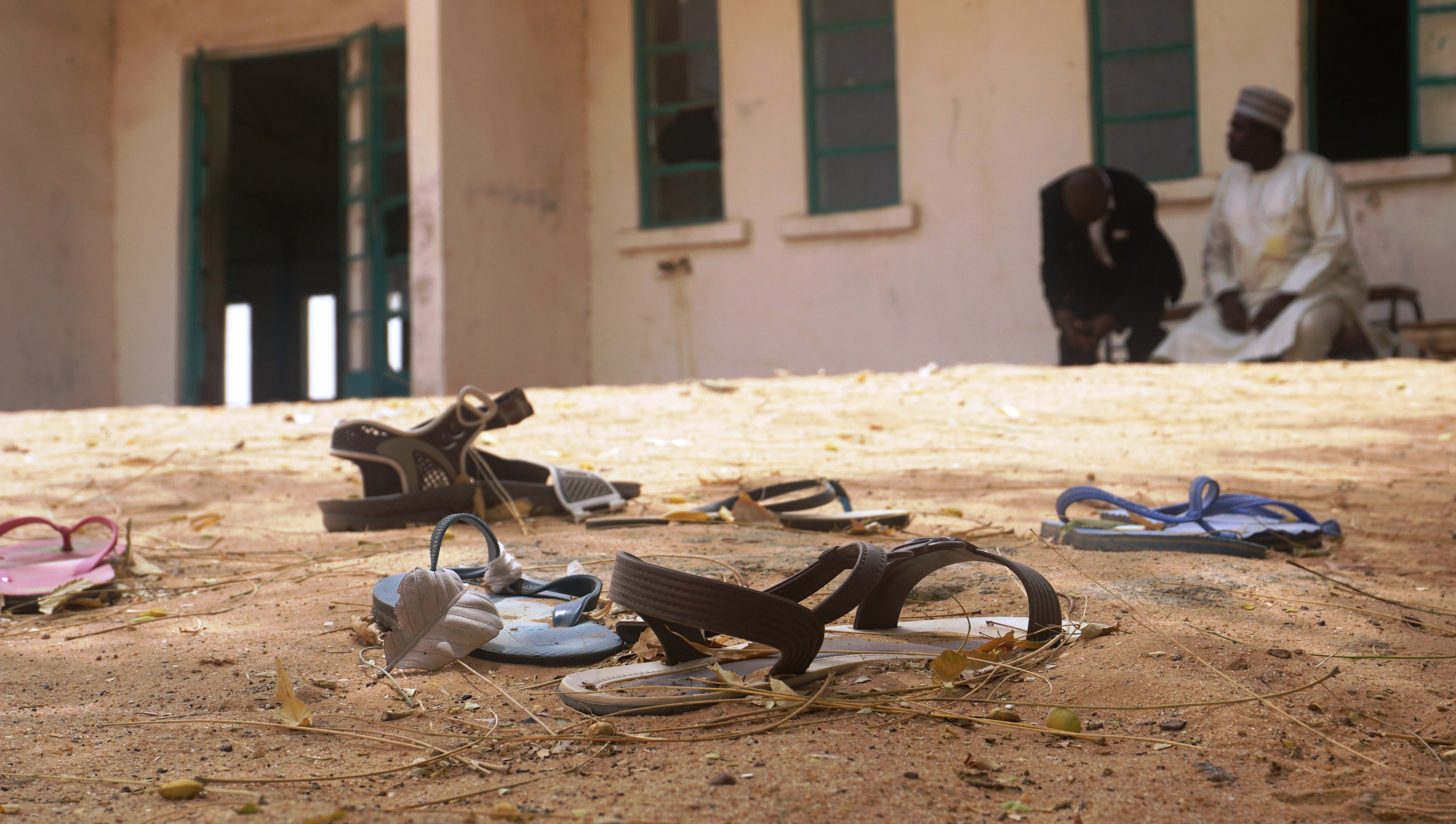Sandals are strewn in the yard of the Government Girls Science and Technical College staff quarters in Dapchi, Nigeria, on Feb. 22, 2018.