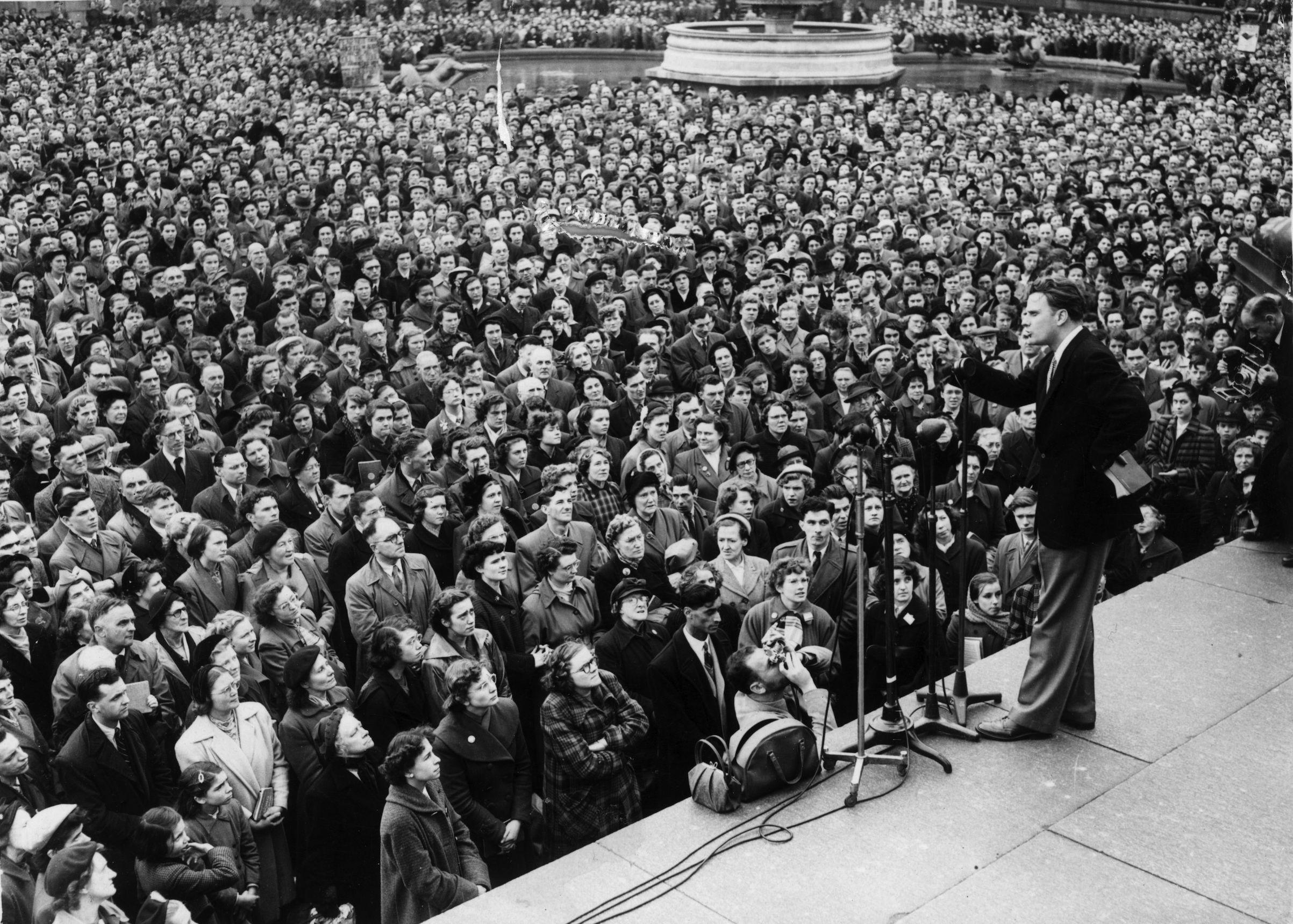 Evangelist Billy Graham addressing the congregation in Trafalgar Square in London in 1954