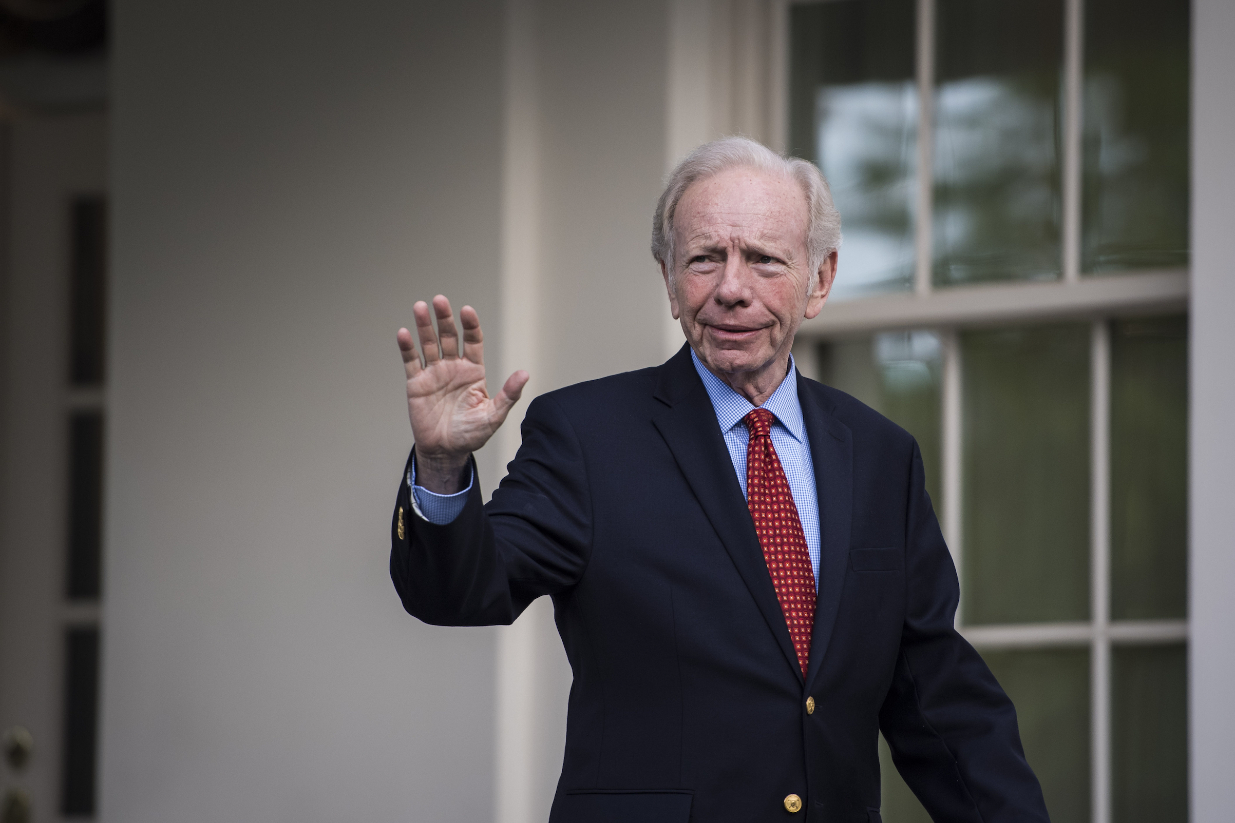 Former Connecticut Sen. Joseph Lieberman walks out of the West Wing after a meeting at the White House in Washington, D.C., on May 17, 2017.