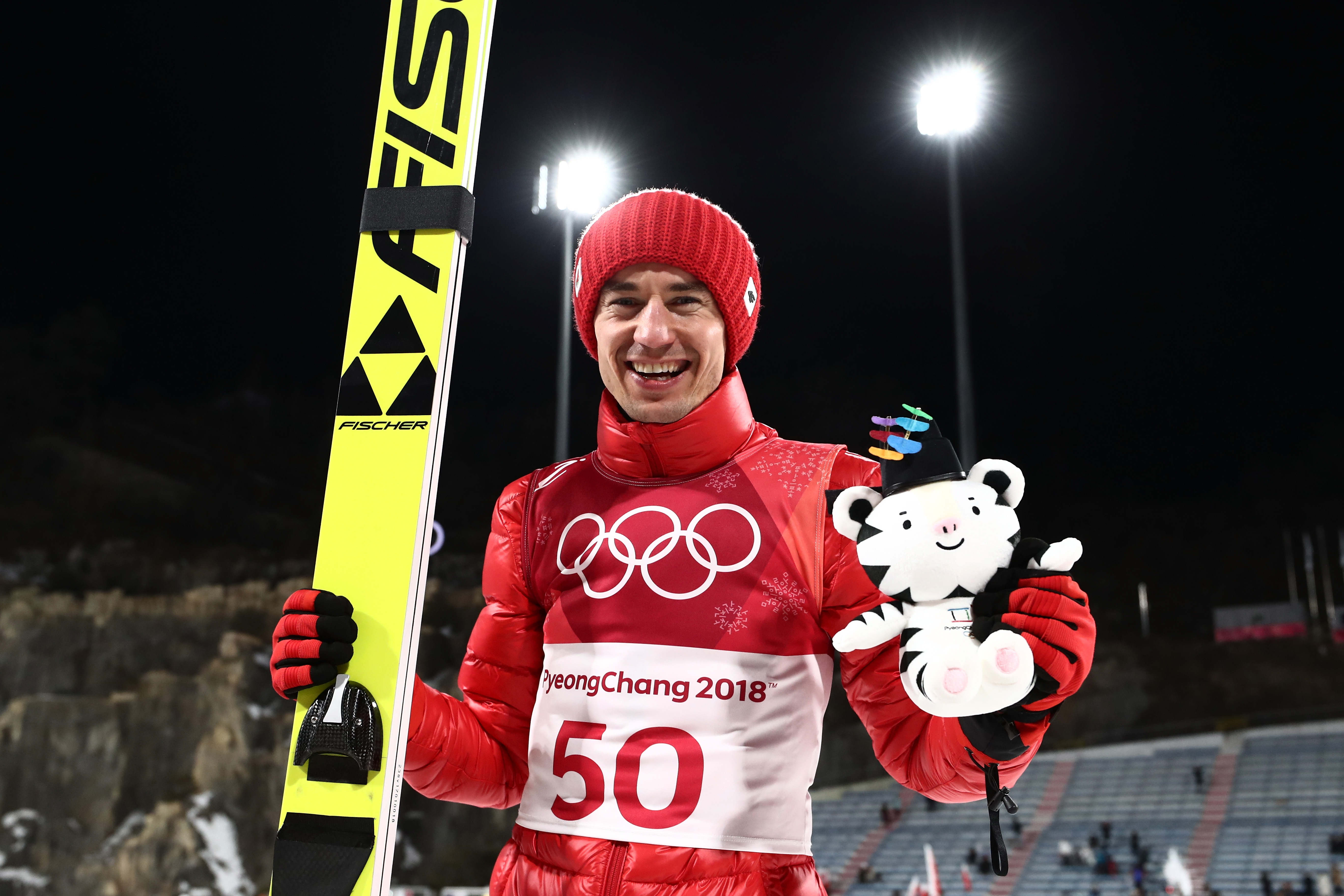 Kamil Stoch of Poland celebrates following the Ski Jumping - Men's Large Hill on day eight of the PyeongChang 2018 Winter Olympic Games .