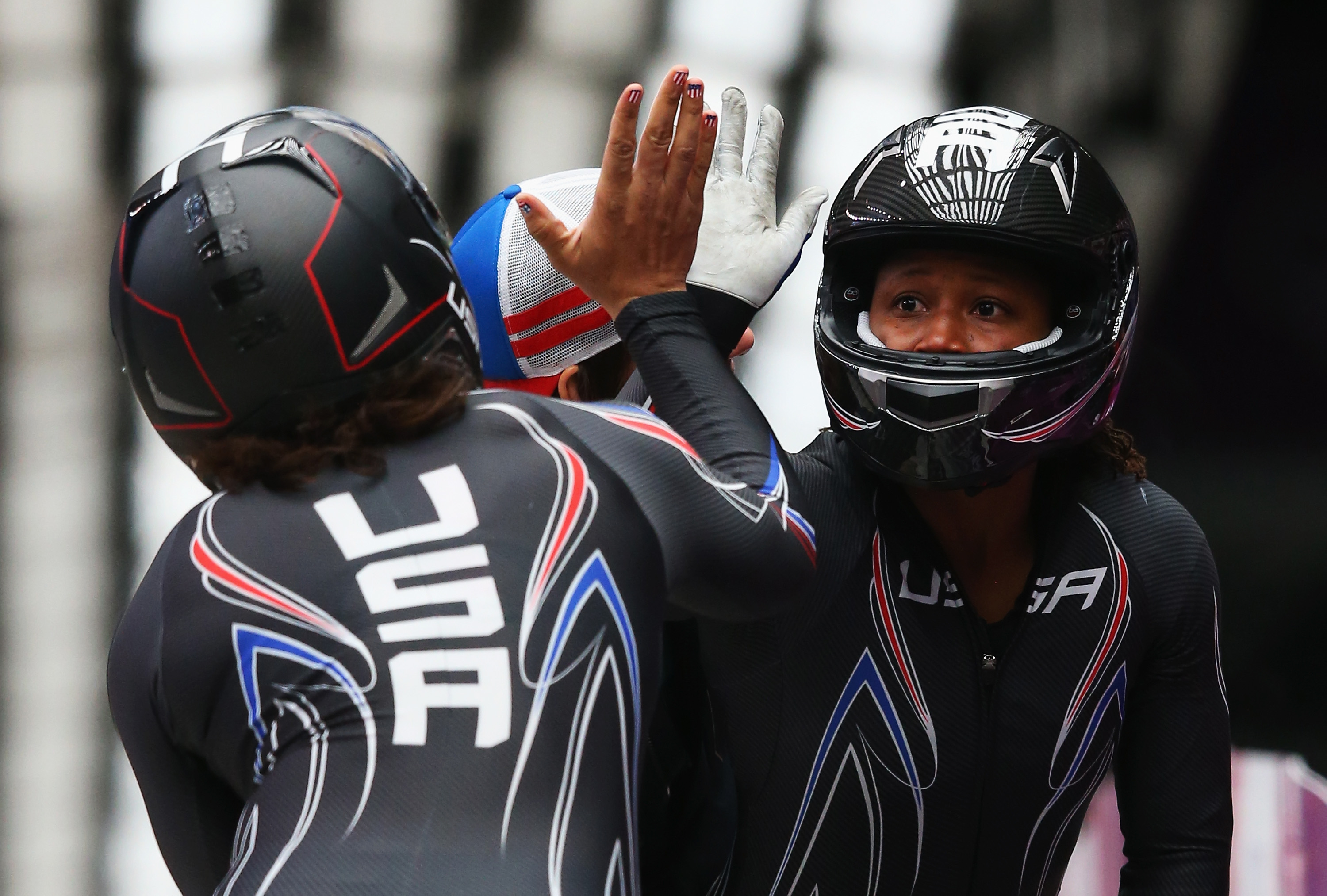 Elana Meyers (left) and Lauryn Williams of the United States team 1 celebrate during the Women's Bobsleigh at the Sochi 2014 Winter Olympics in Russia. Alex Livesey—Getty Images