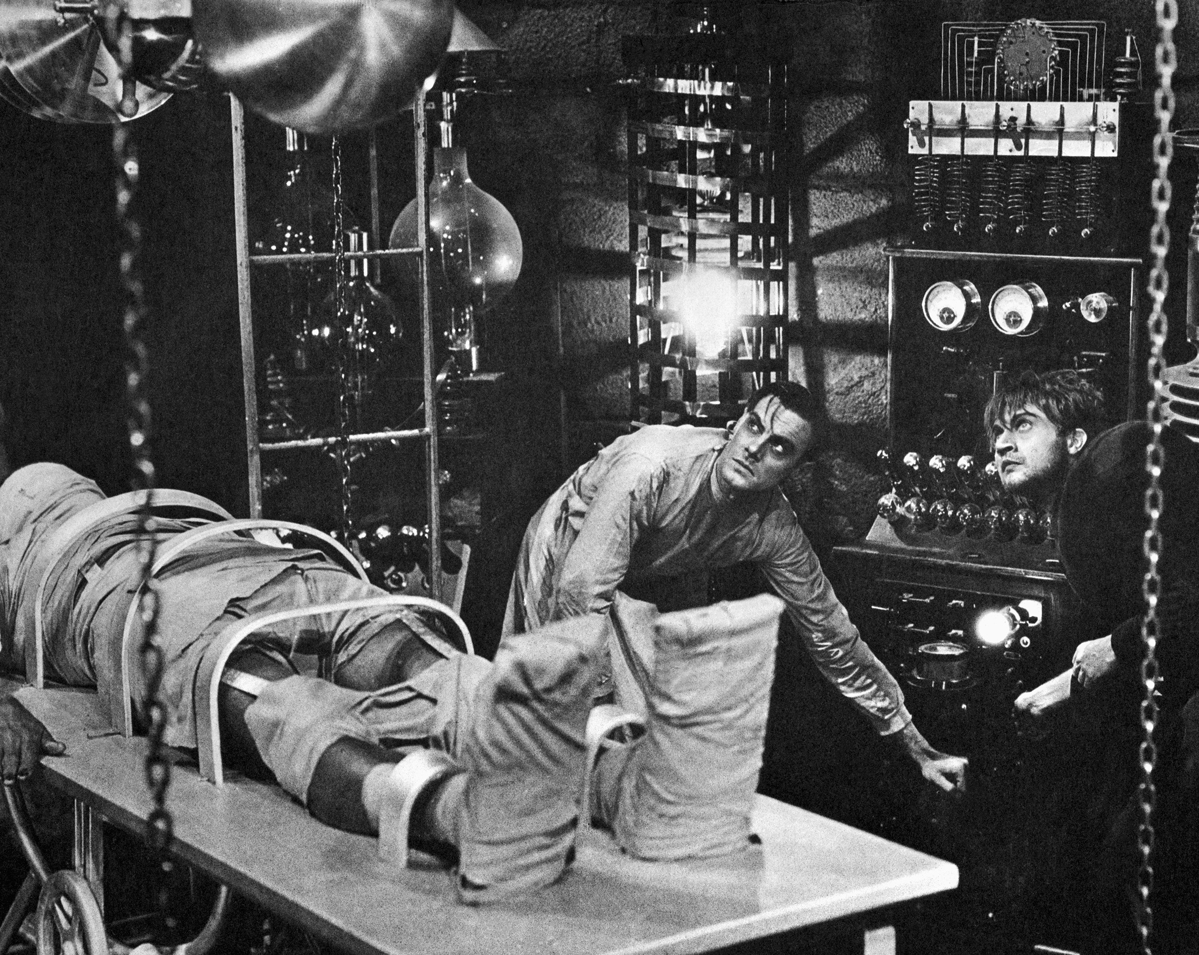 Colin Clive, as Dr. Frankenstein, and Dwight Frye, as his assistant Fritz, prepare to bring their monster to life in a scene from the 1931 movie version of Mary Shelley's Frankenstein.