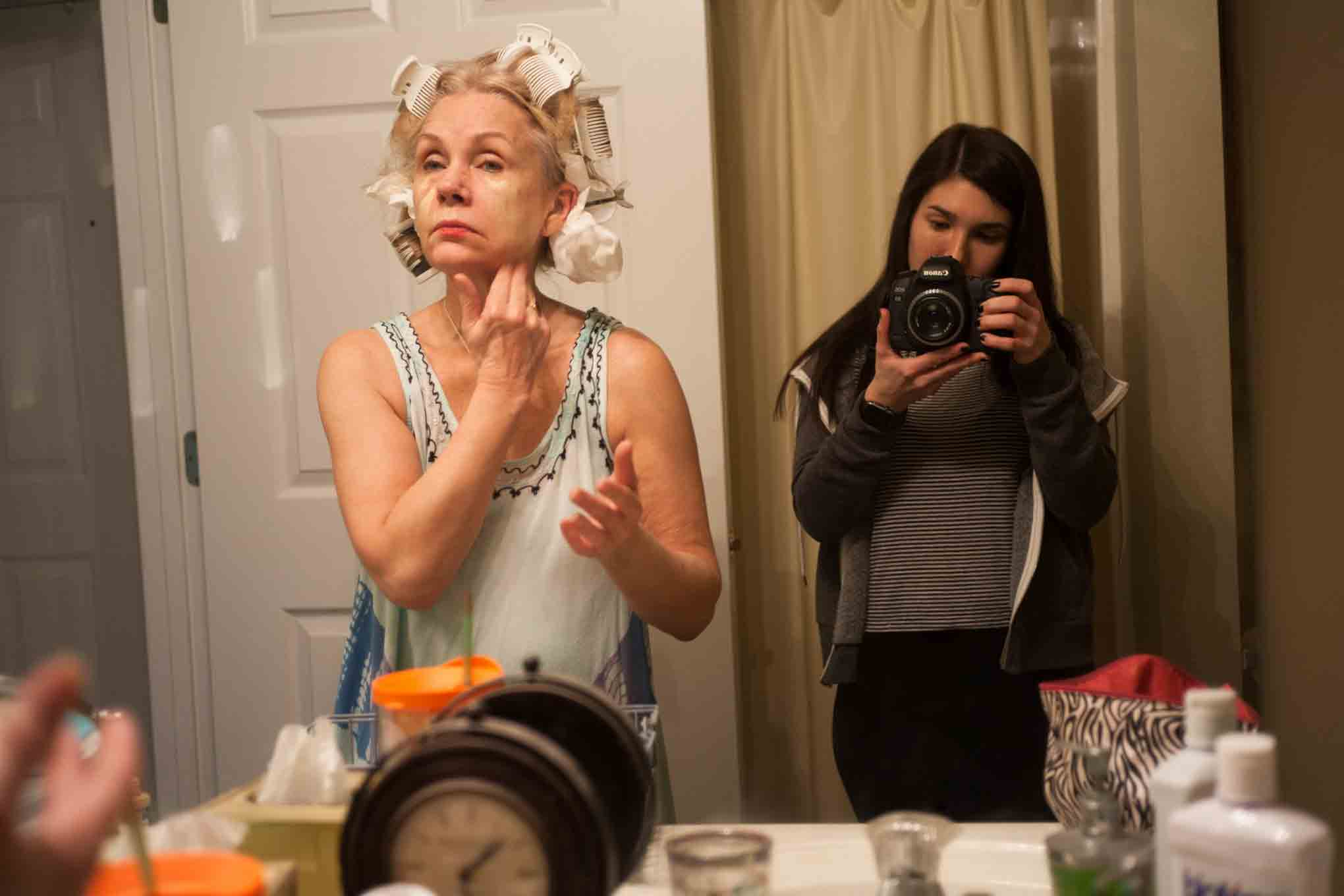 Spitz calls this photo of her mother applying makeup Mom's Mask