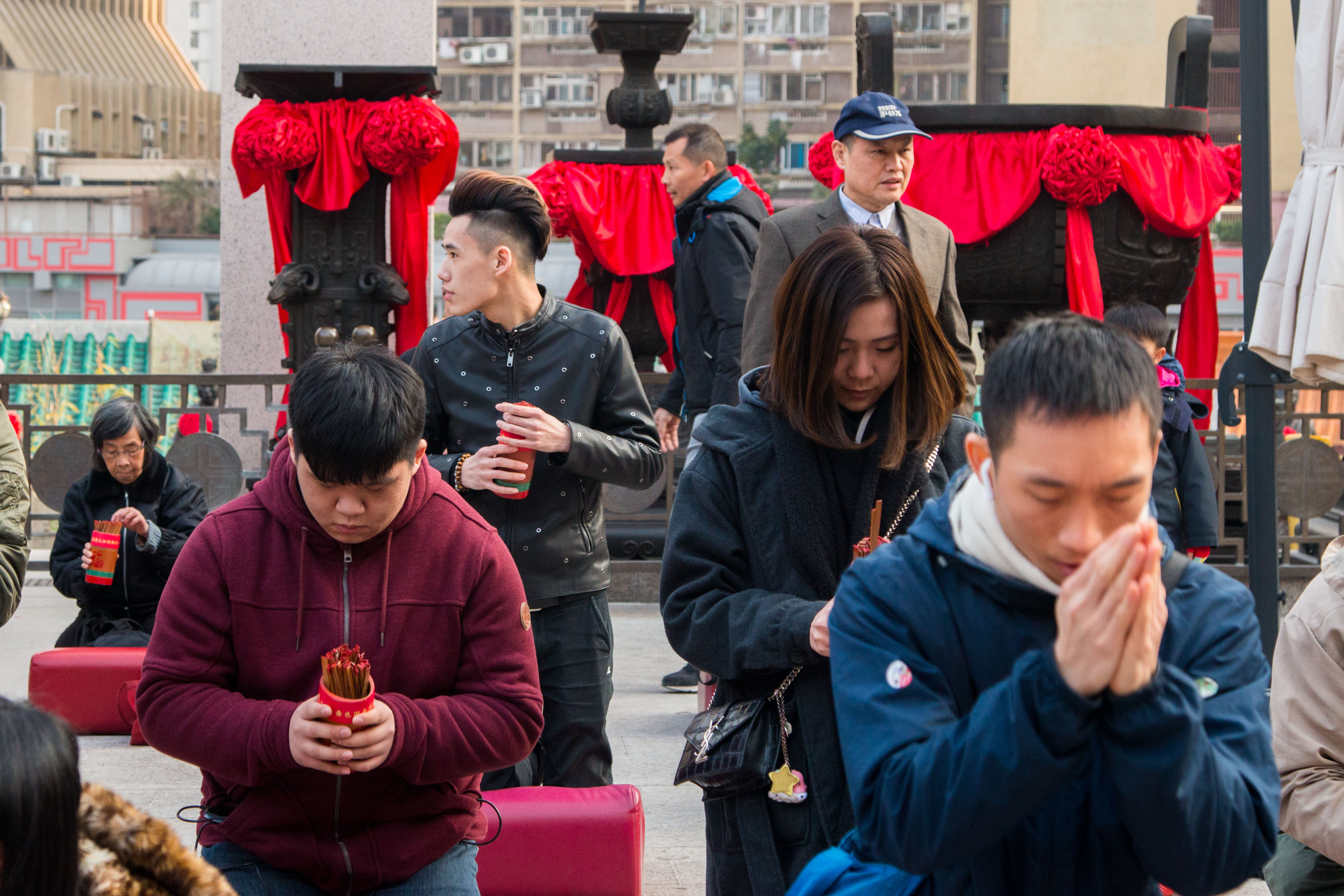 Worshippers with kau cim divination sticks at Wong Tai Sing temple in Hong Kong on Feb. 4, 2018.