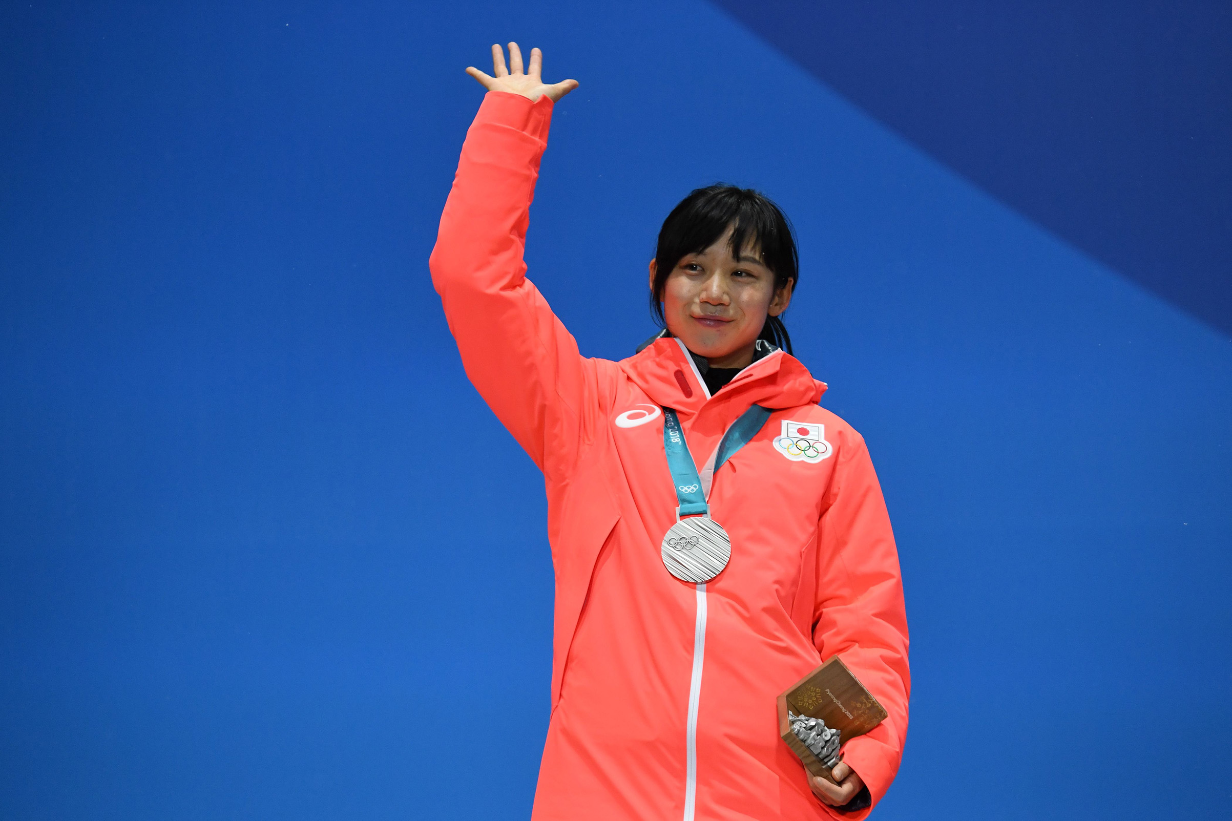 Japan's silver medallist Miho Takagi waves on the podium during the medal ceremony for the speed skating women's 1500m on Feb. 13, 2018.