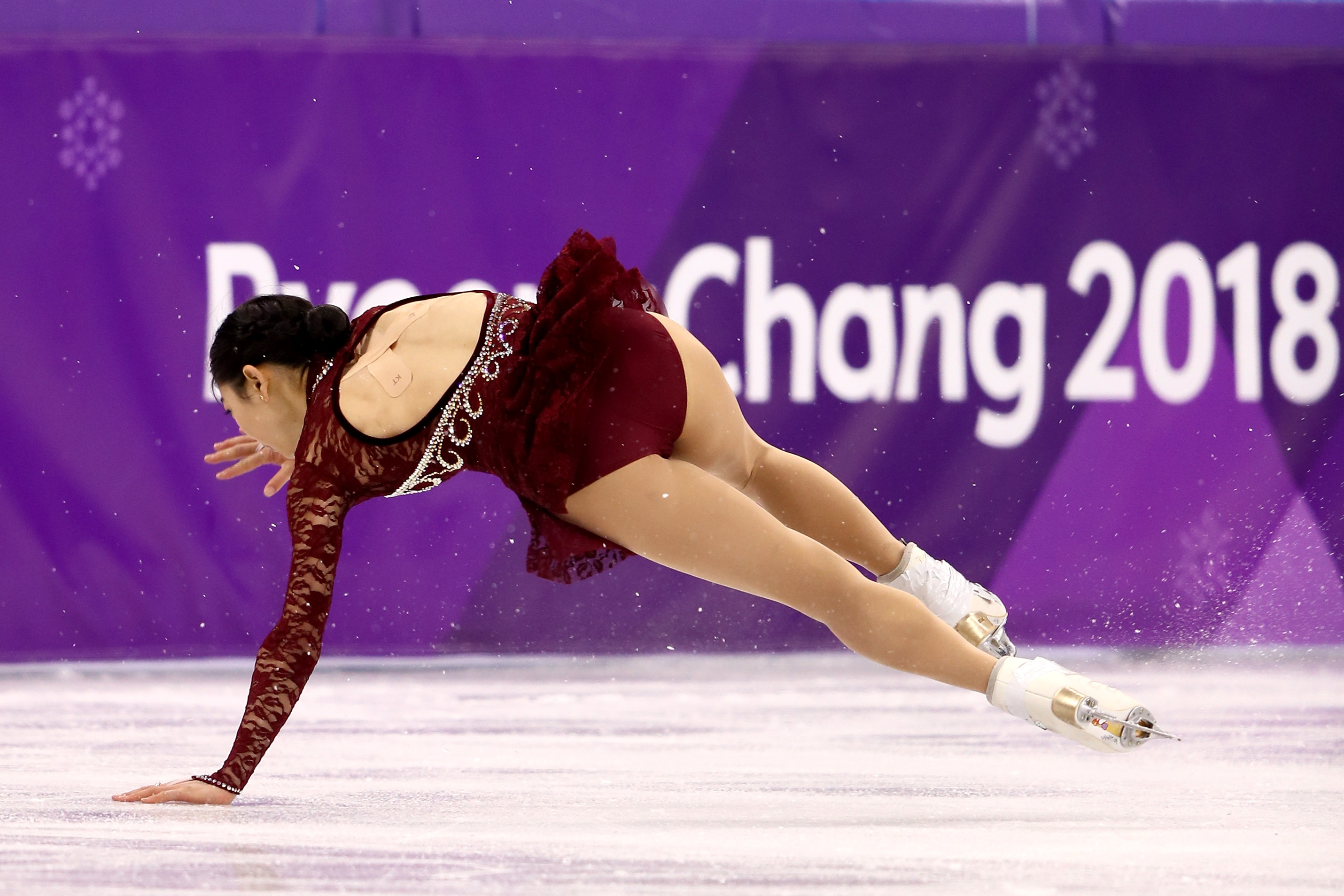 Mirai Nagasu of the United States falls while competing during the Ladies Single Skating Short Program on day twelve of the PyeongChang 2018 Winter Olympic Games at Gangneung Ice Arena on February 21, 2018 in Gangneung, South Korea