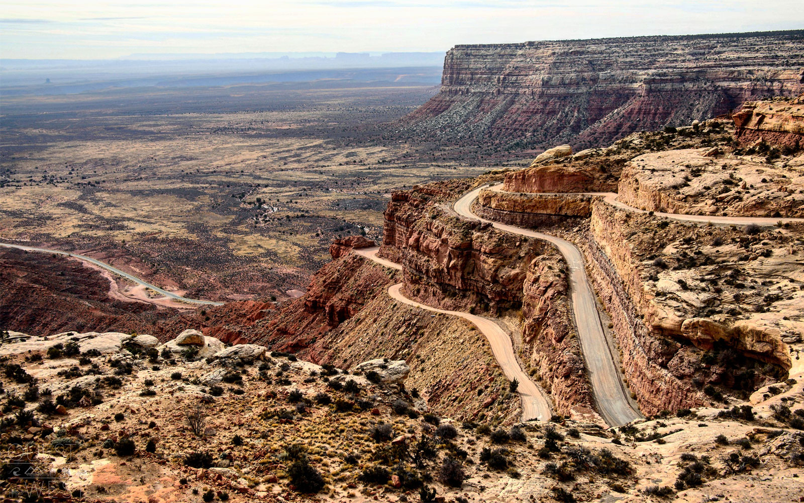 "The Moki Dugway, which is located at the western end of the Valley of the Gods road, a graded dirt switchback road carved into the edge of Cedar Mesa.                               The unpaved and steep roads can be dangerous and should be approached with caution, but many tourists brave the drive for the end result. From the top, visitors are treated to sweeping views over the Valley of the Gods (famous for its buttes and towering pinnacles) and Monument Valley in the distance.                               ""You get an amazing 180-degree view of the entire valley that's just filled with red and orange rock formations throughout,"" Paquette recalled."
