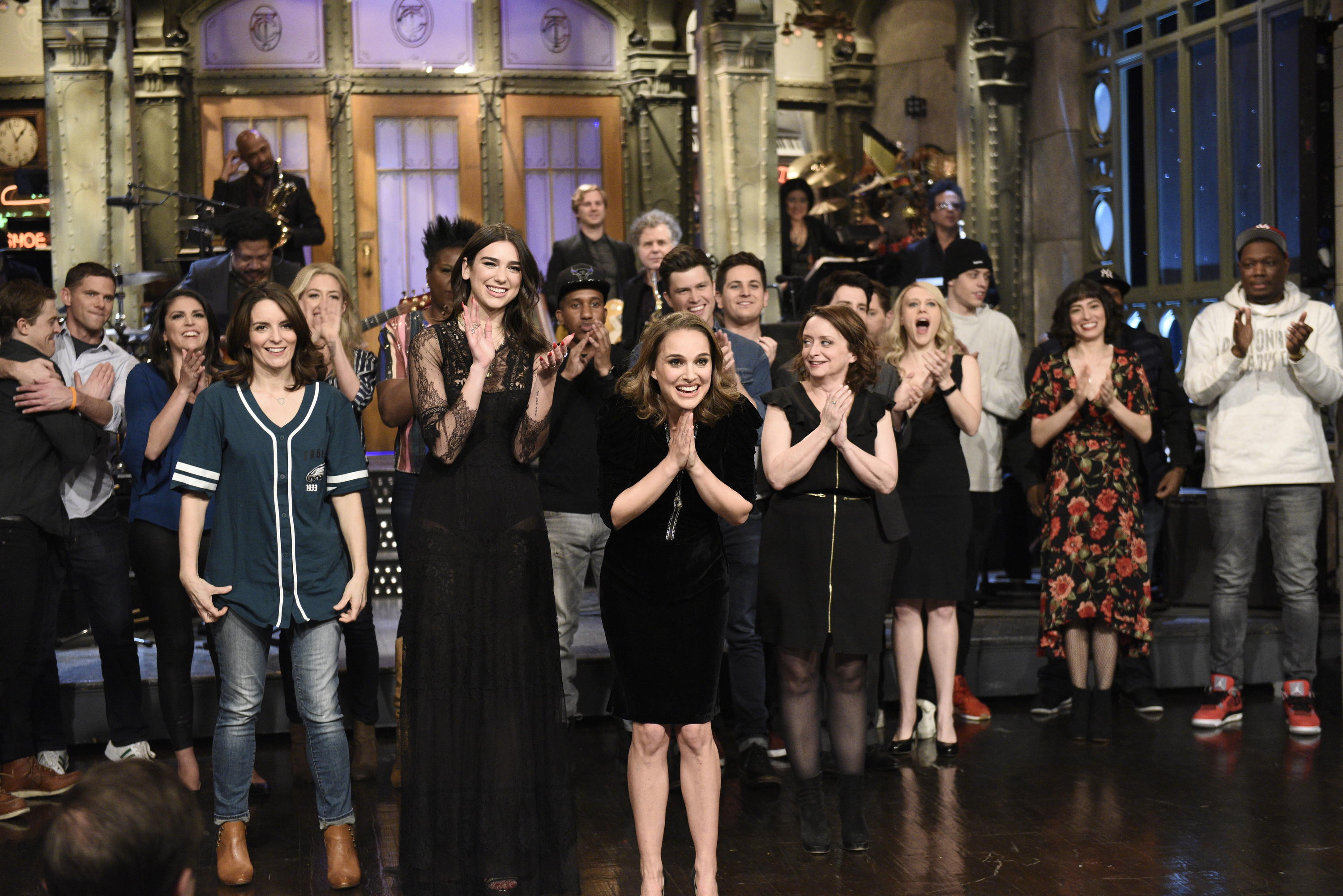 SATURDAY NIGHT LIVE -- Episode 1738  Natalie Portman  -- Pictured: (l-r) Alex Moffat, Mikey Day, Cecily Strong, Tina Fey, Dua Lipa, Chris Redd, Natalie Portman, Colin Jost, Luke Null, Rachel Dratch, Kate McKinnon, Pete Davidson, Melissa Villaseñor, Michael Che during  Goodnights & Credits  in Studio 8H on Saturday, February 3, 2018 -- (Photo by: Will Heath/NBC)