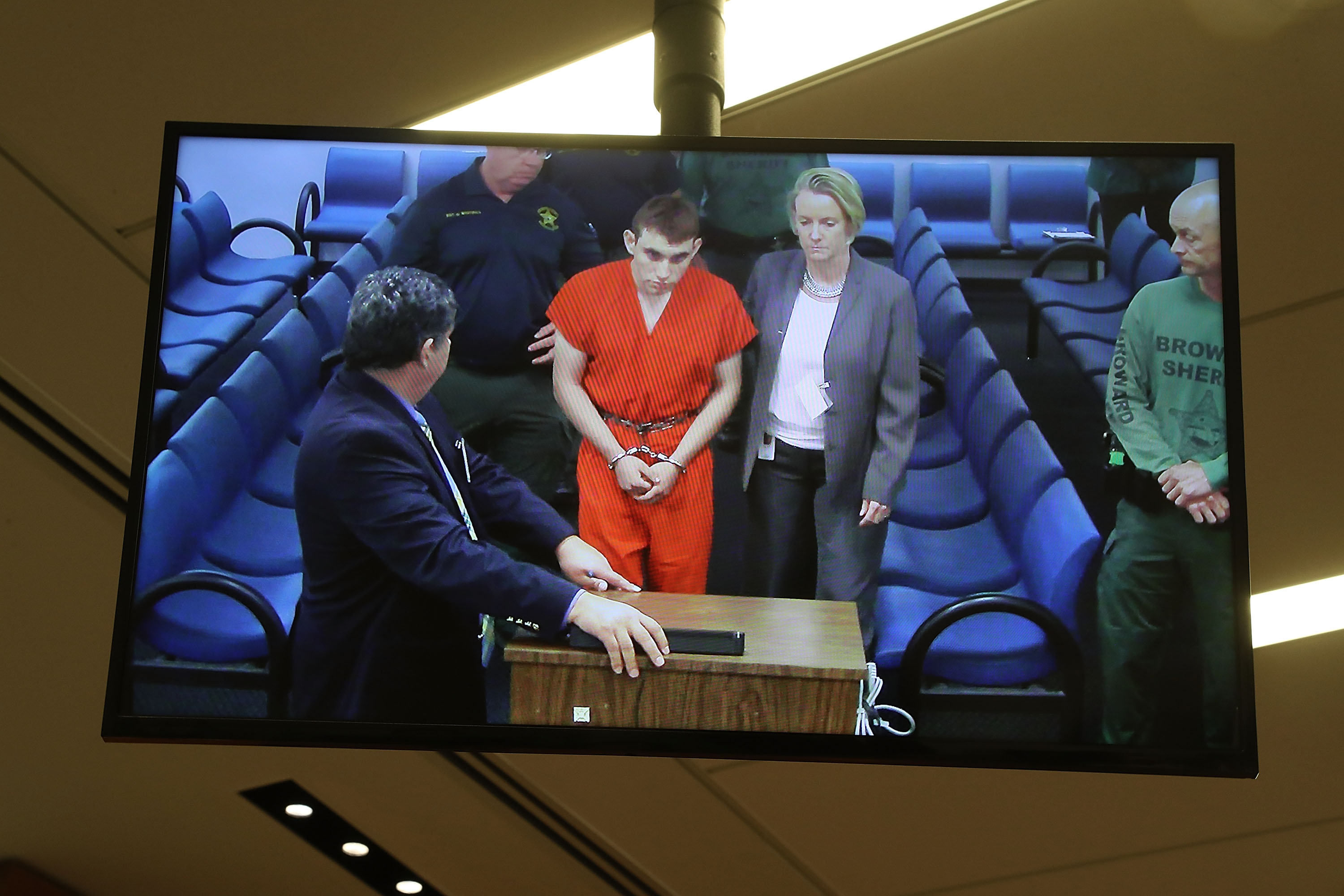 FORT LAUDERDALE, FL - FEB. 15: Nikolas Cruz, 19, a former student at Marjory Stoneman Douglas High School in Parkland, Fla., where he allegedly killed 17 people, is seen on a closed circuit television screen during a bond hearing. (Photo by Susan Stocker - Pool/Getty Images)