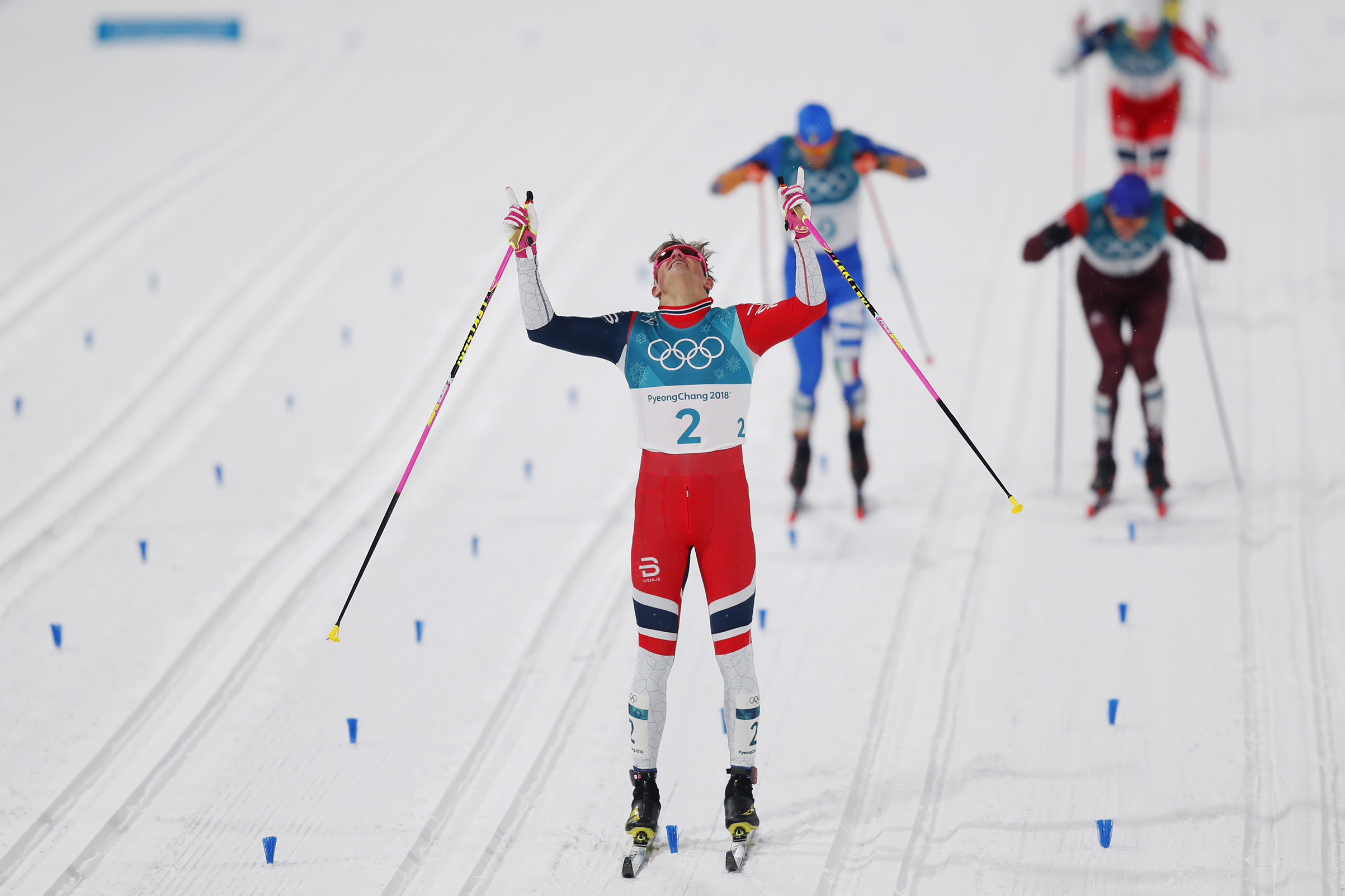 Johannes Hoesflot Klaebo of Norway celebrates after the victory during the Mens Individual Sprint Classic Finals on Feb. 13, 2018.