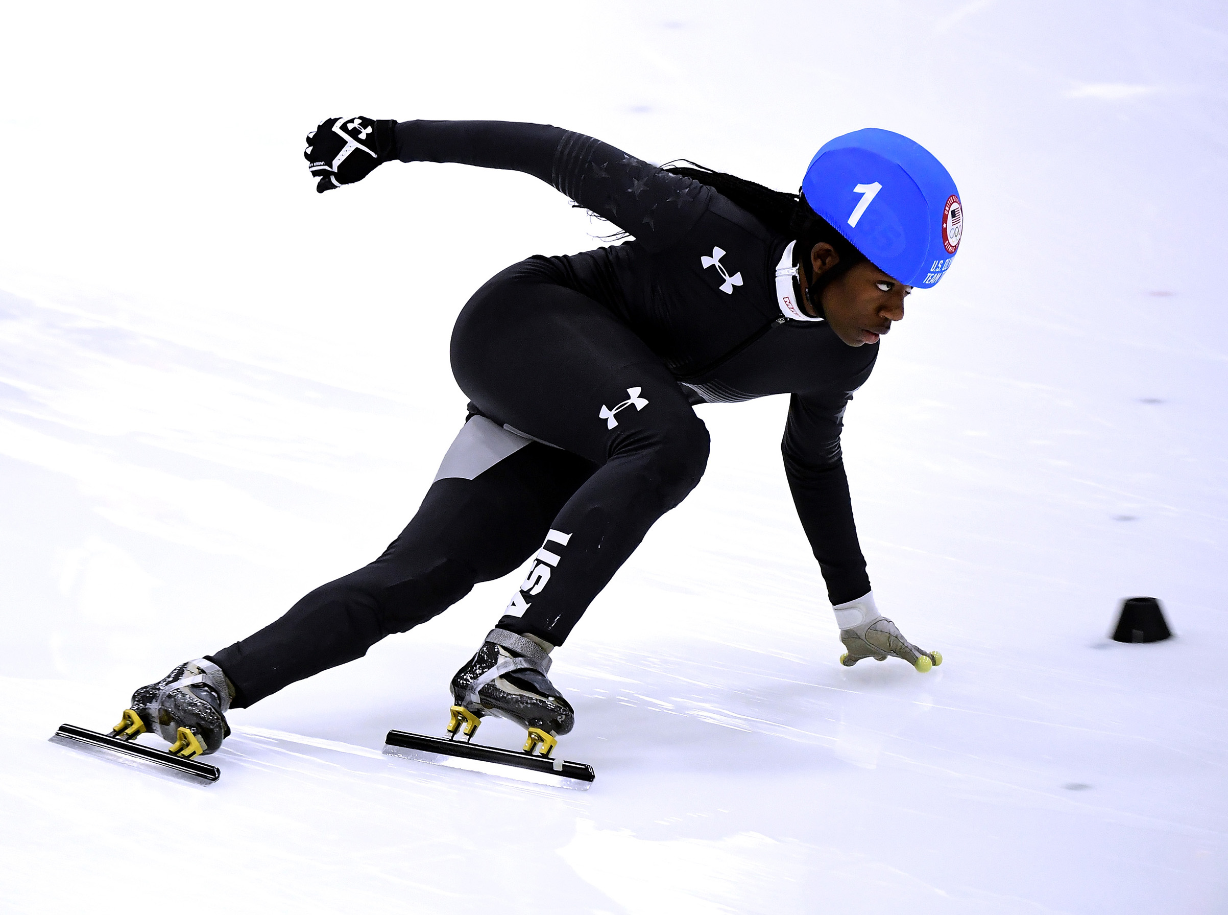 Olympic athlete Maame Biney takes the corner on her way to victory in the Women's 500 Meter A Final for a spot on the 2018 Olympic team on Dec. 16, 2017. Harry How—Getty Images