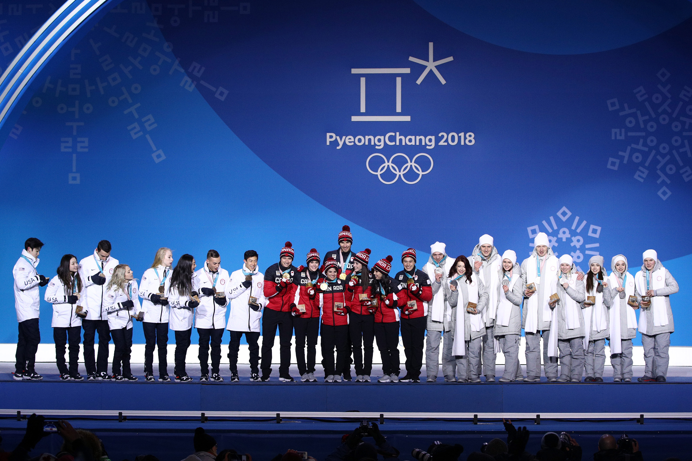 Silver medalists Team Olympic Athlete from Russia, gold medalists Team Canada and bronze medalists Team United States celebrate during the medal ceremony after the Figure Skating Team Event at Medal Plaza on Feb. 12, 2018 in Pyeongchang-gun, South Korea.