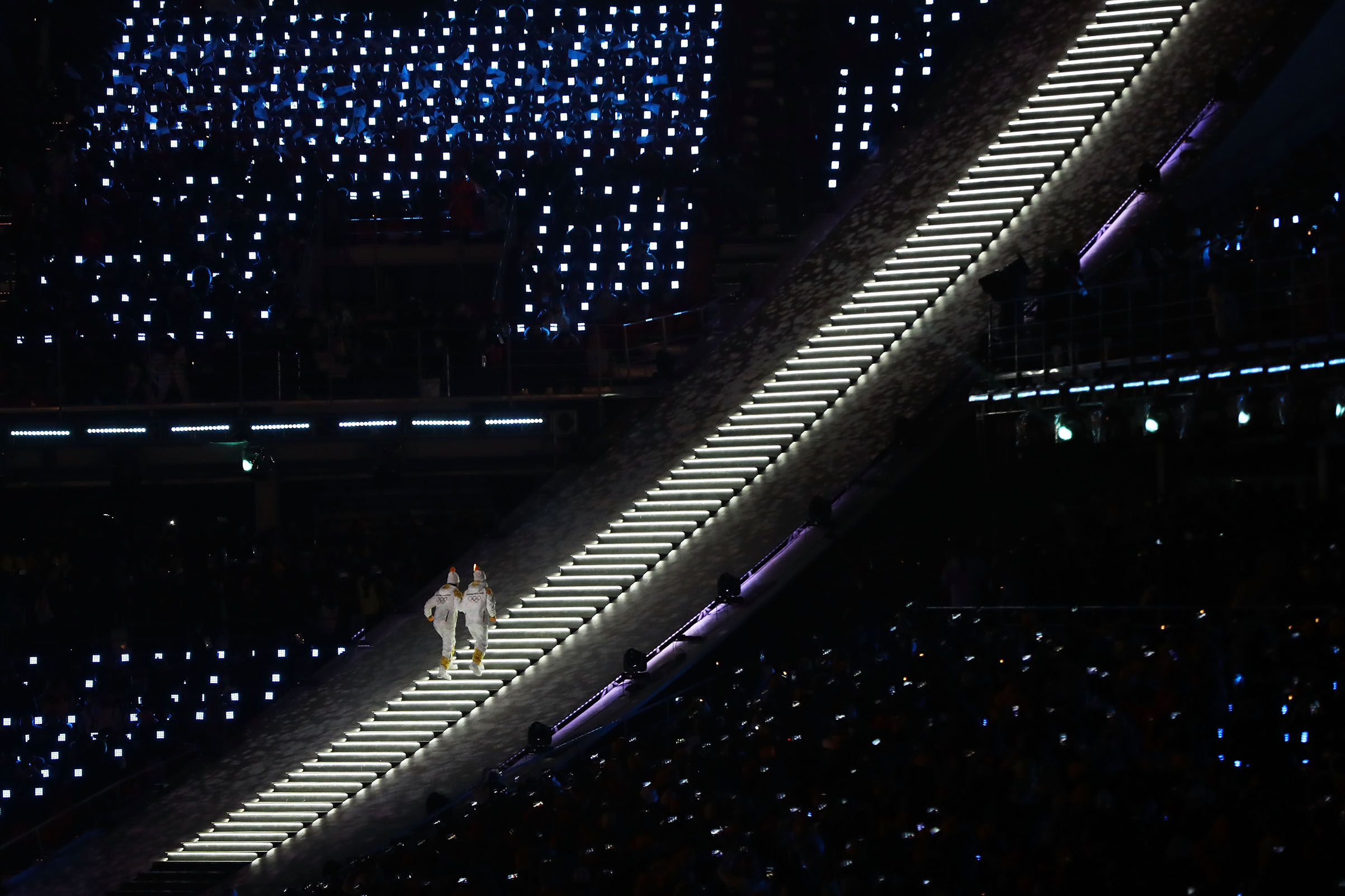 Torchbearer with the Olympic Flame during the Opening Ceremony of the PyeongChang 2018 Winter Olympic Games.