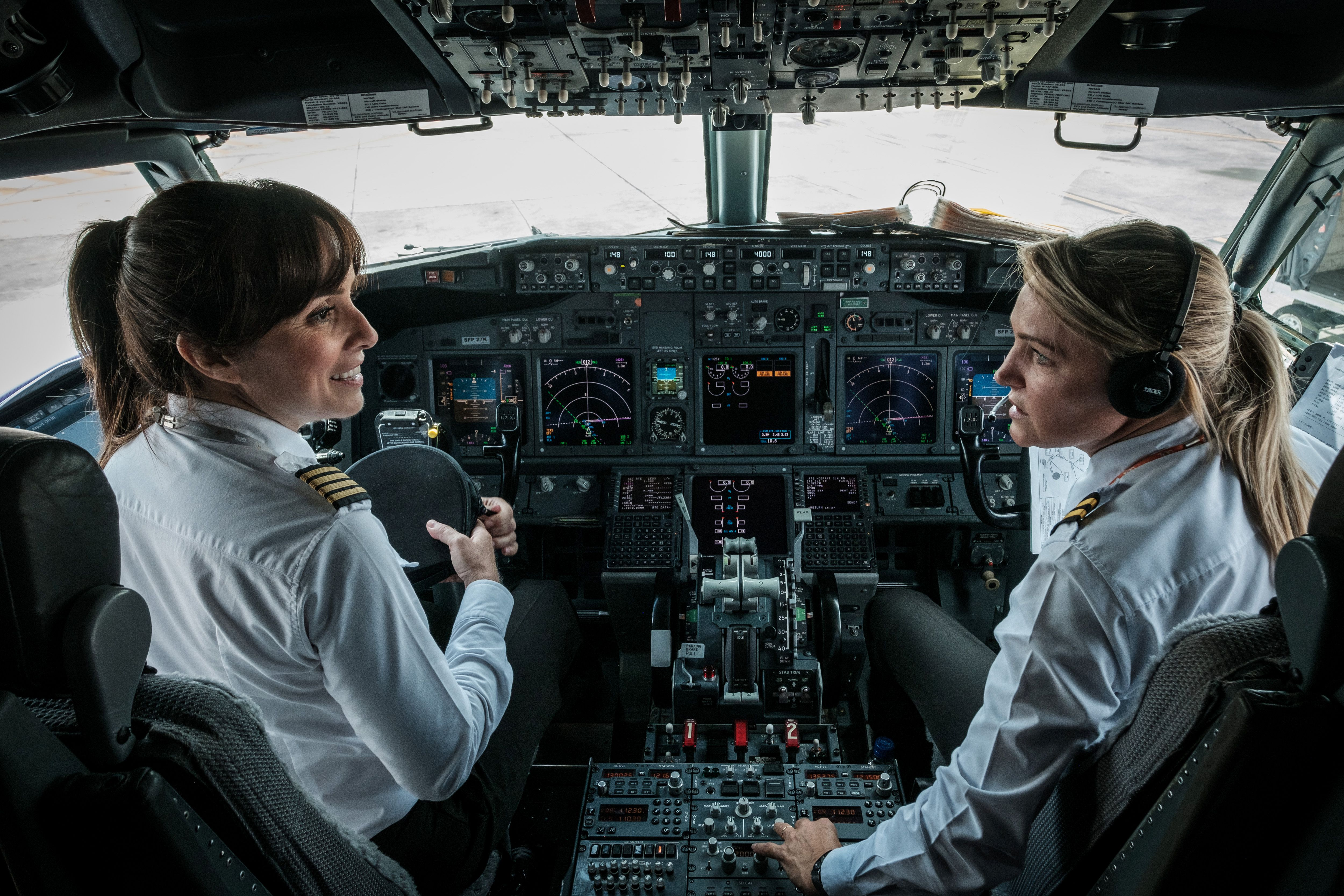 Brazilian airline GOL pilot Gabriela Carneiro Duarte (L) and her co-pilot prepare to take off on an all female crew flight to mark International Women's Day at Tom Jobim international airport, in Rio de Janeiro, Brazil, on March 8, 2017.