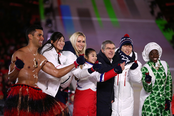 President of the International Olympic Committee Thomas Bach and Lee Hee-beom, President & CEO of PyeongChang Organizing Committee stand on the stage with Lindsey Vonn of the United States, Pita Taufatofua of Tonga and Olympic athletes during the Closing Ceremony of the PyeongChang 2018 Winter Olympics.
