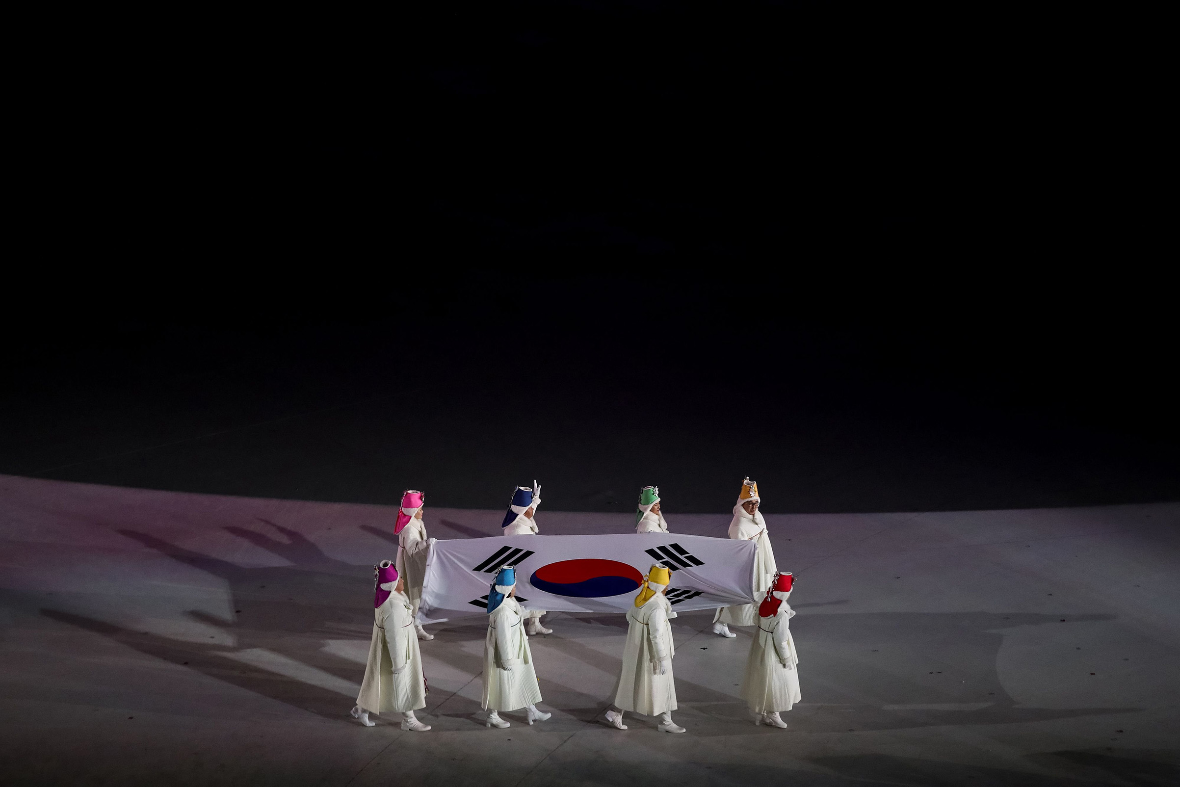 Former South Korean Olympians carry the South Korean flag during the opening ceremony of the Pyeongchang 2018 Winter Olympic Games.
