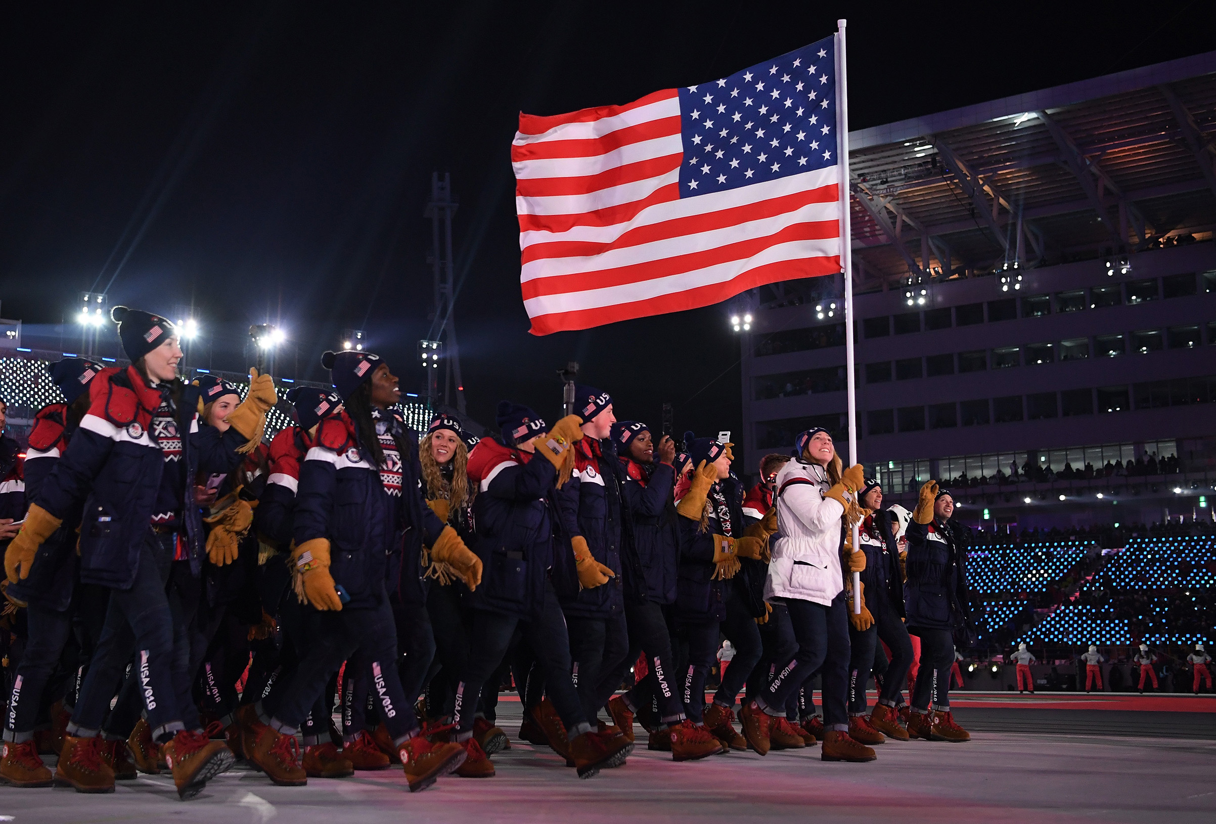 Flag bearer Erin Hamlin of the United States leads the team in the Parade of Athletes during the Opening Ceremony of the PyeongChang 2018 Winter Olympic Games.