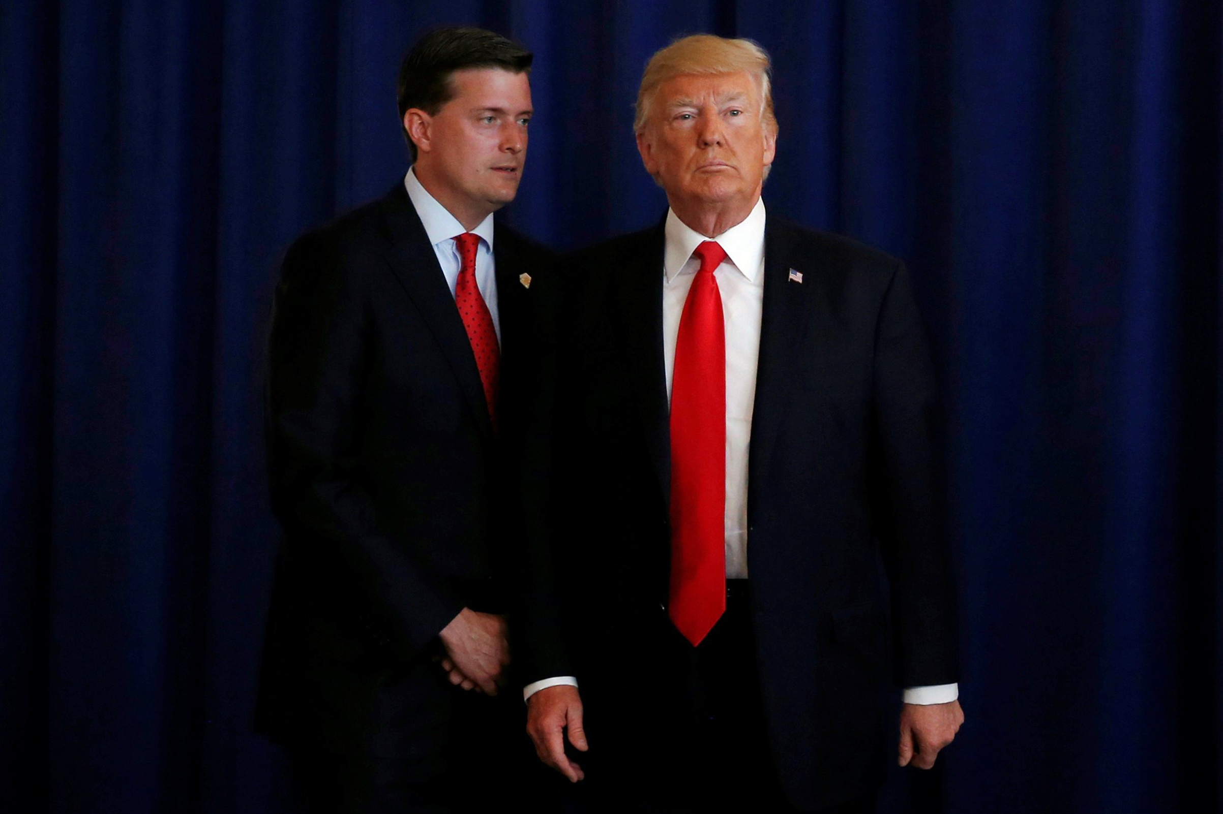 White House Staff Secretary Rob Porter speaks to President Donald Trump at his golf estate in Bedminster, New Jersey, Aug. 12, 2017.