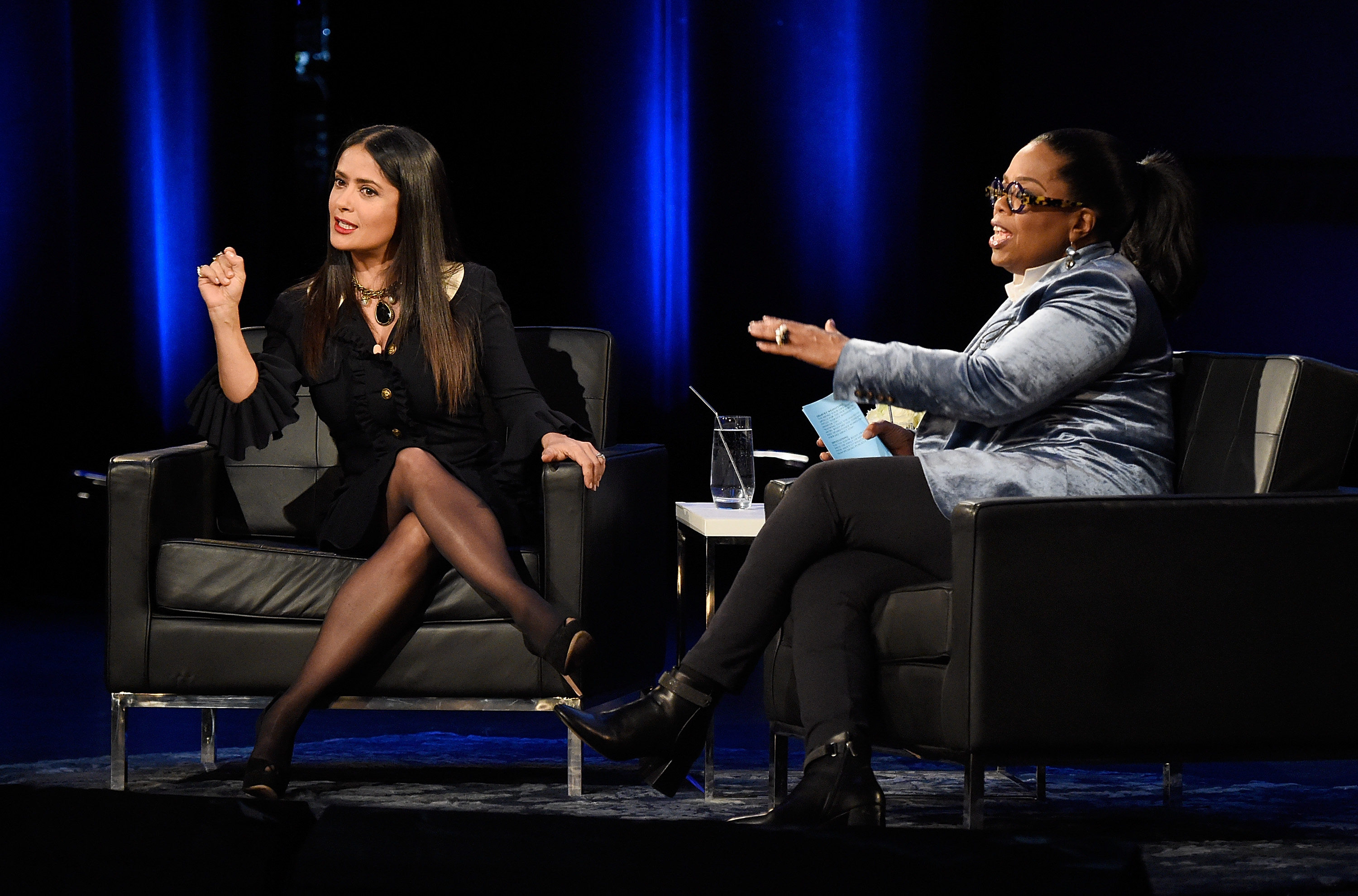 Salma Hayek Pinault and Oprah speak onstage during  Oprah's Super Soul Conversations  at The Apollo Theater on February 7, 2018 in New York City