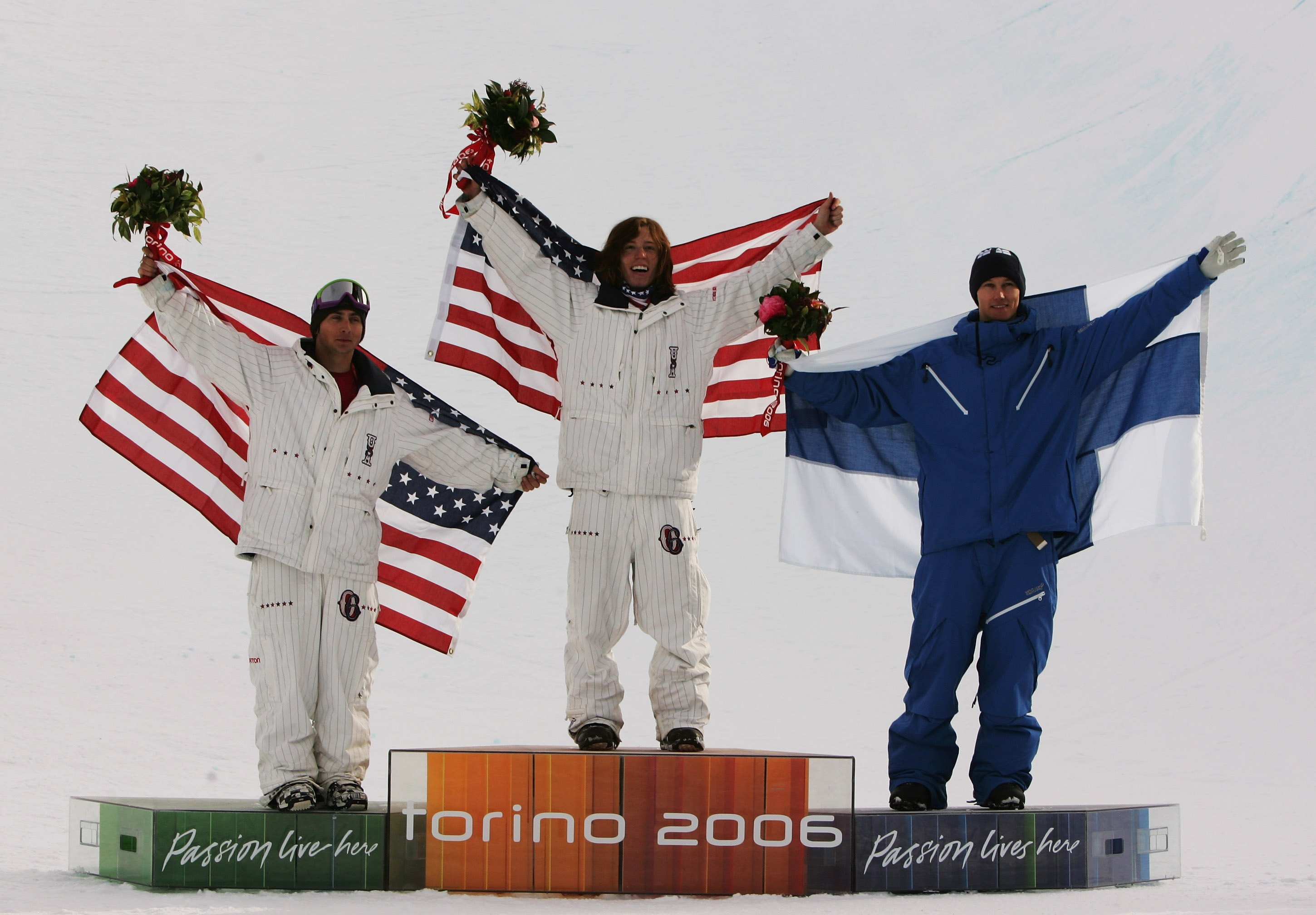 Shaun White (C) celebrates after winning the Gold Medal with teammate Daniel Kass (L) and Markku Koski of Finland in the Mens Snowboard Half Pipe Final at the 2006 Turin Winter Olympic Games in Bardonecchia, Italy. Adam Pretty—Getty Images
