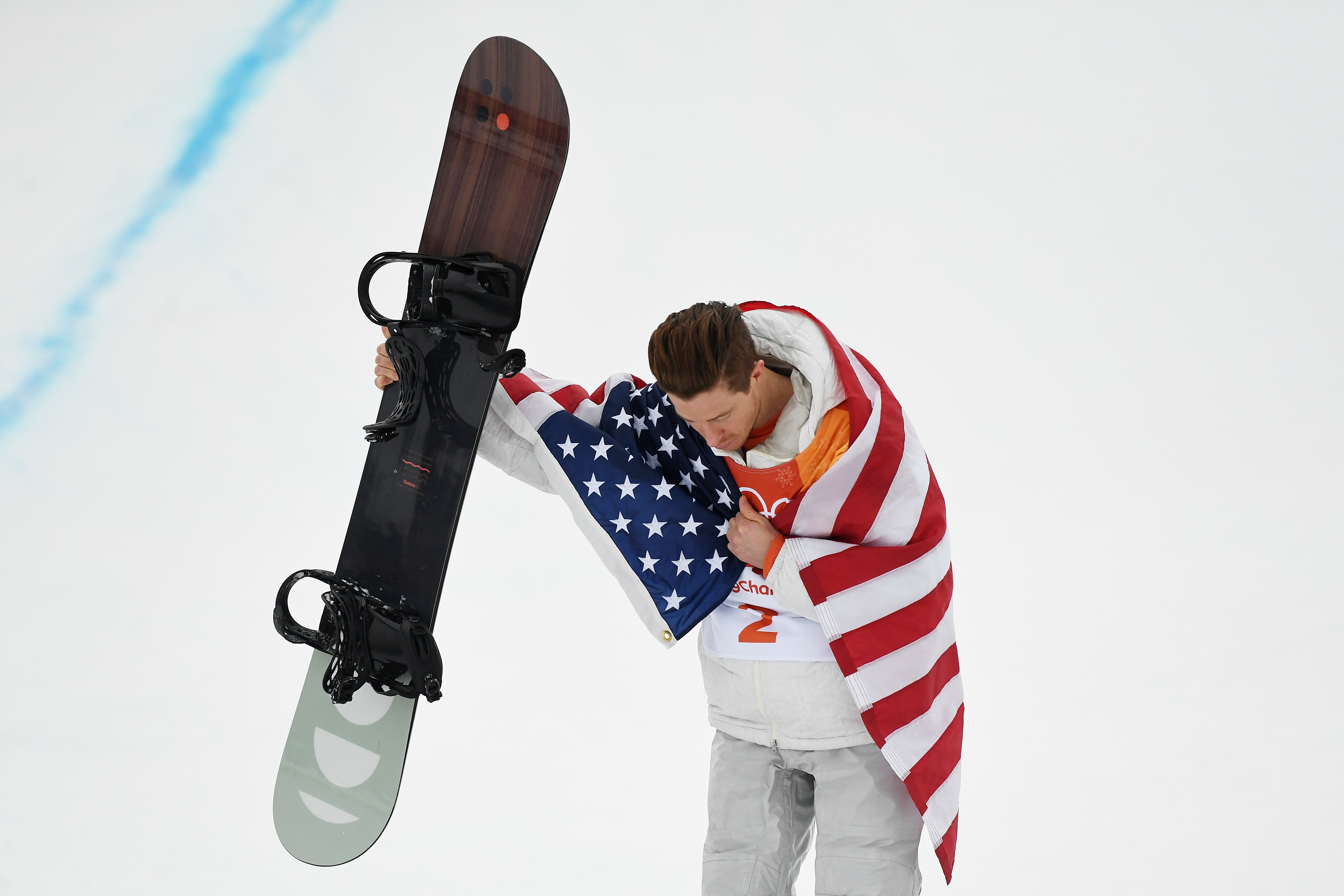 Gold medalist Shaun White of the United States poses during the victory ceremony for the Snowboard Men's Halfpipe Final on day five of the Winter Olympics in Pyeongchang-gun, South Korea, on Feb. 14, 2018.