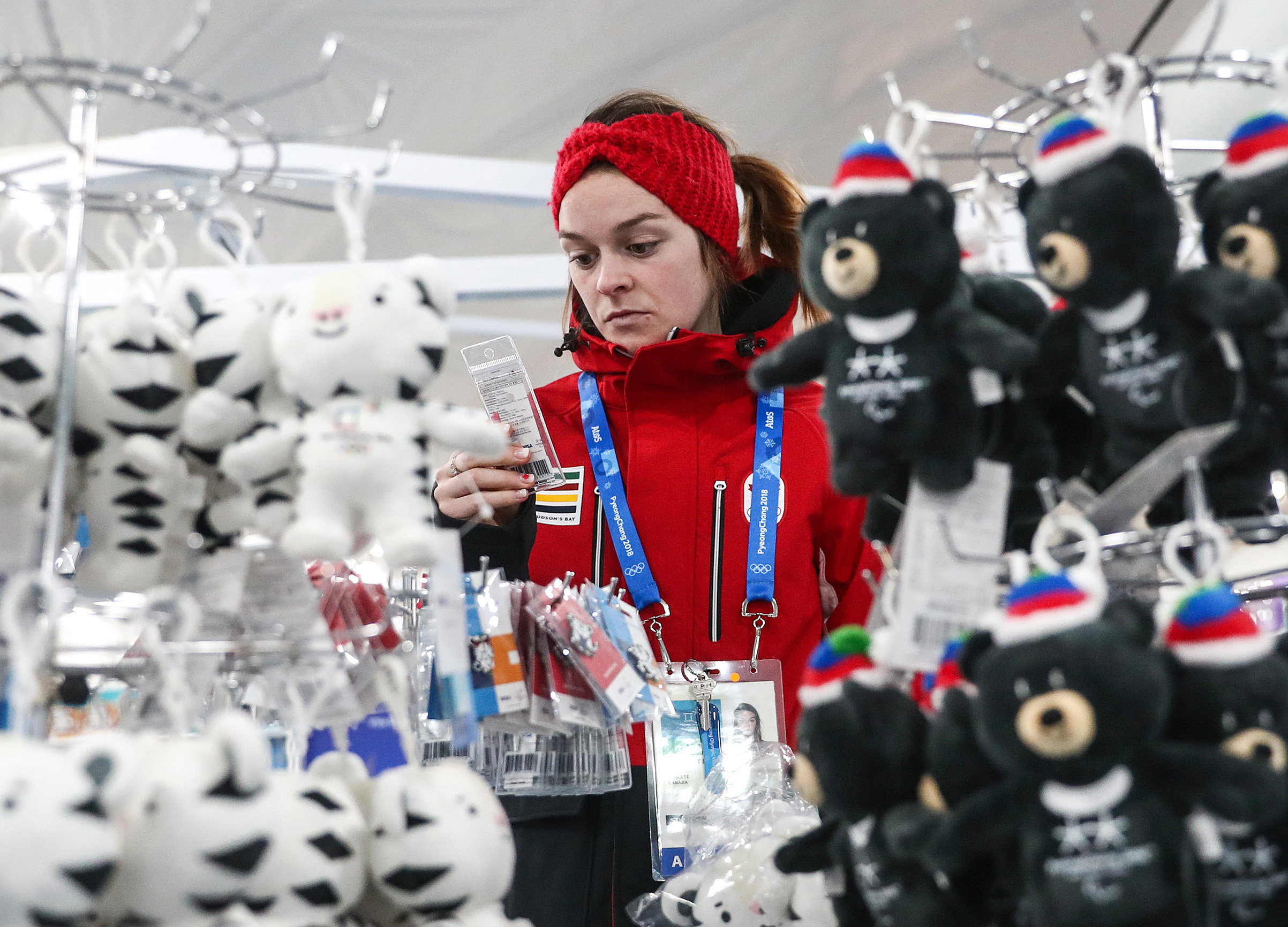 A girl seen by suffed toys of Soohorang and Bandabi, the official mascots of the 23rd Winter Olympic Games and the 12th Winter Paralympic Games in Pyeongchang respectively, on sale in the Olympic Village ahead of the 2018 Winter Olympic Games.