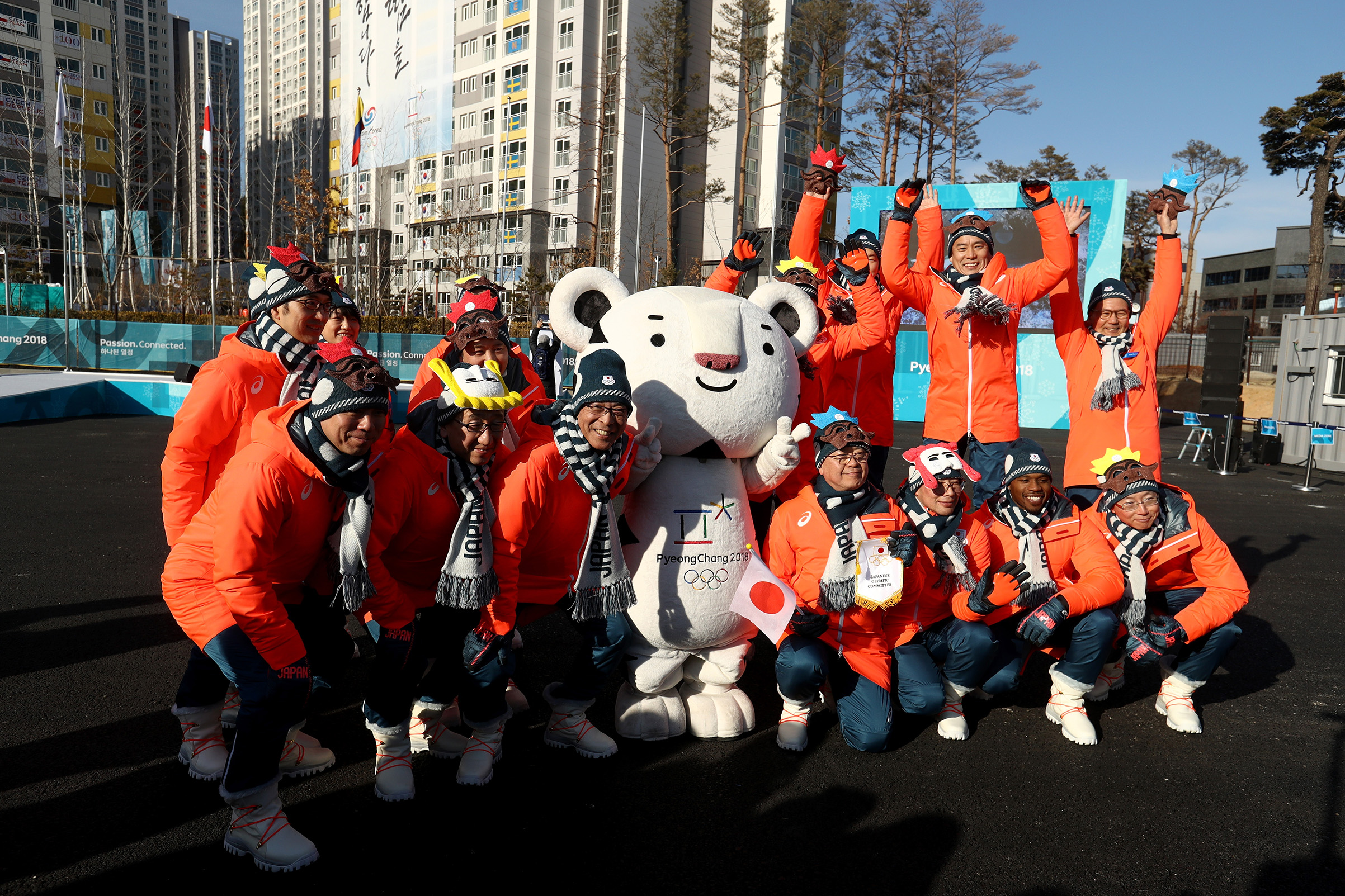 Members of the Japan team pose with mascot Soohorang ahead of the PyeongChang 2018 Winter Olympic Games on Feb. 7, 2018.