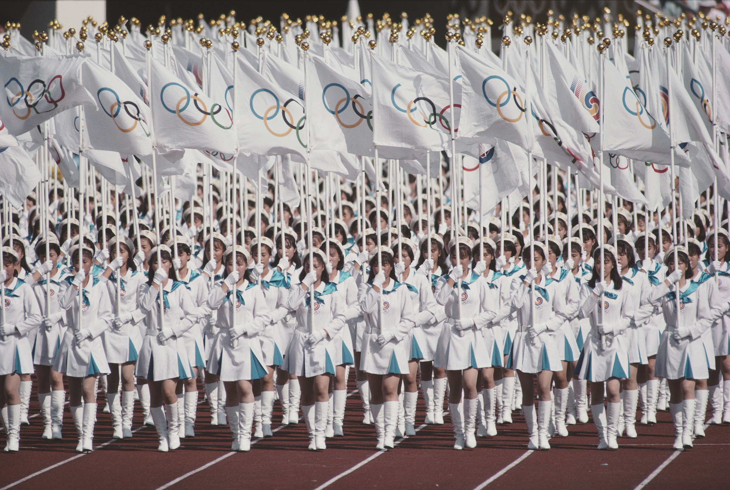 The Olympic Flag is presented in the Olympic Stadium during the Opening Ceremony of the XXIV Summer Olympic Games on Sep. 17, 1988, at the Seoul Olympic Stadium in Seoul, South Korea.