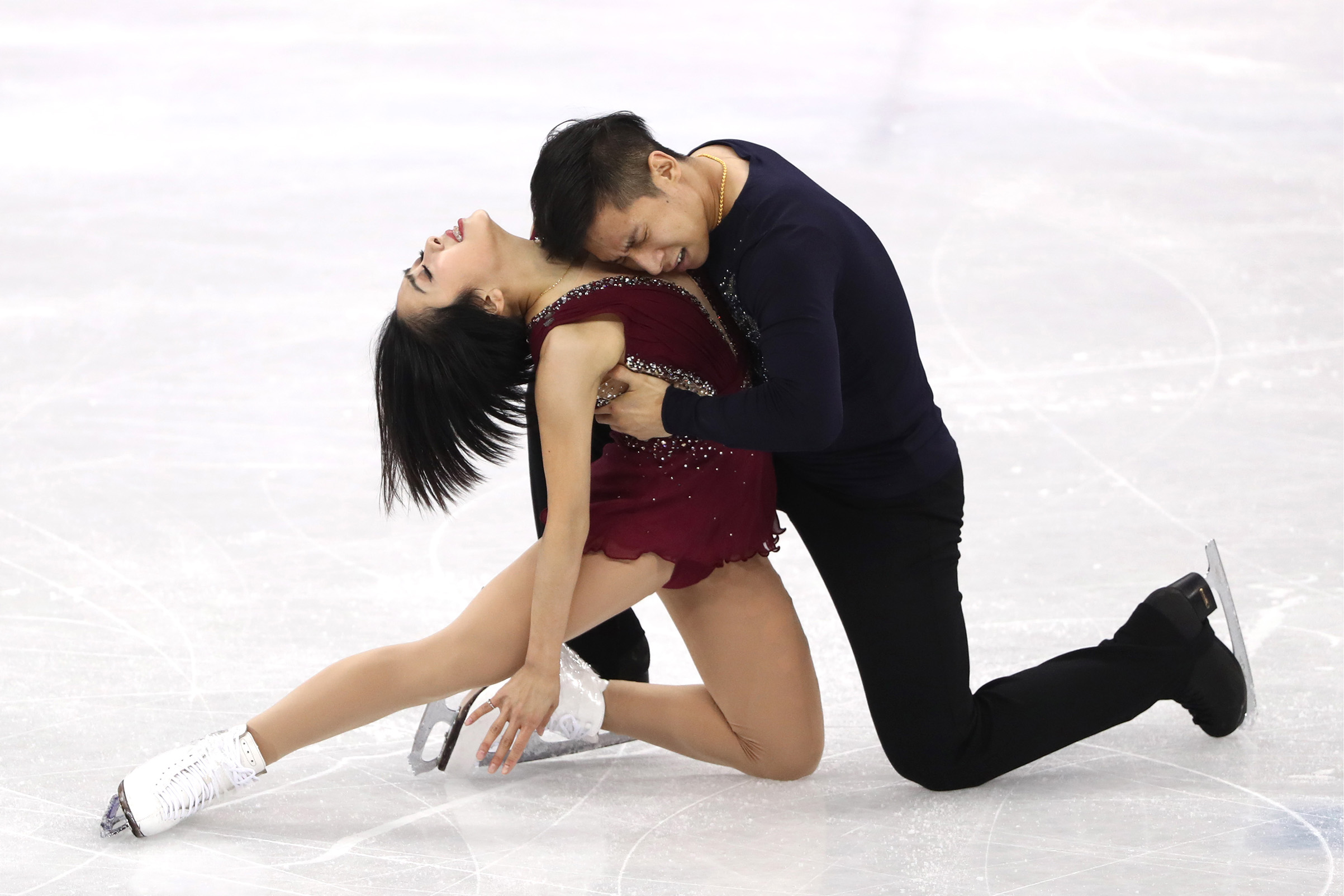 China's pair skaters Sui Wenjing and Han Cong perform their short program during a figure skating event at the 2018 Winter Olympic Games at Gangneung Ice Arena.