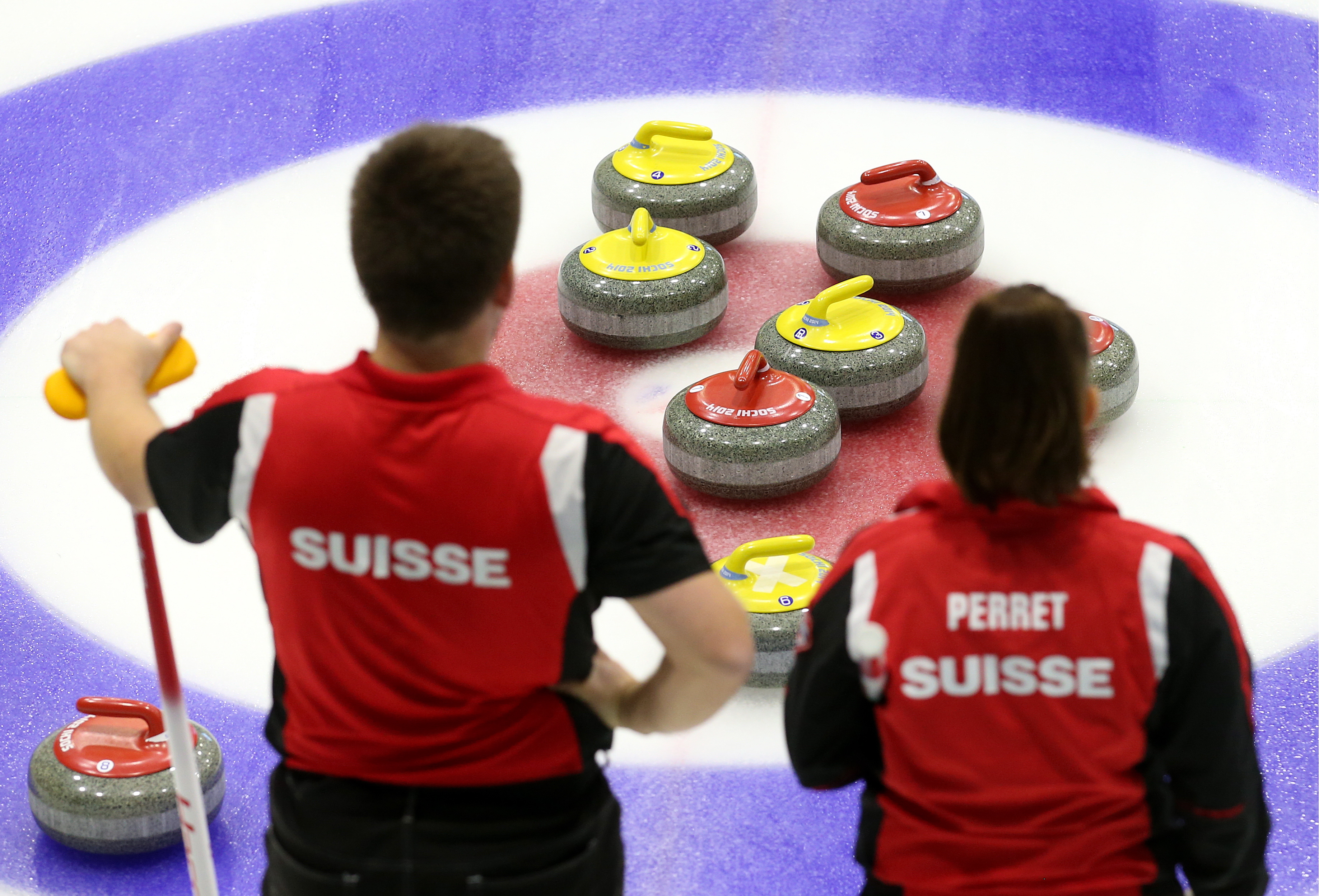 Martin Rios (L) and Jenny Perret of Team Perret (Glarus, Switzerland) in a match against Team Moskaleva (Dmitrov, Russia) at International Mixed Doubles Sochi 2017, an event of the 2017-2018 World Mixed Doubles Curling Tour, at the Ice Cube Curling Center.