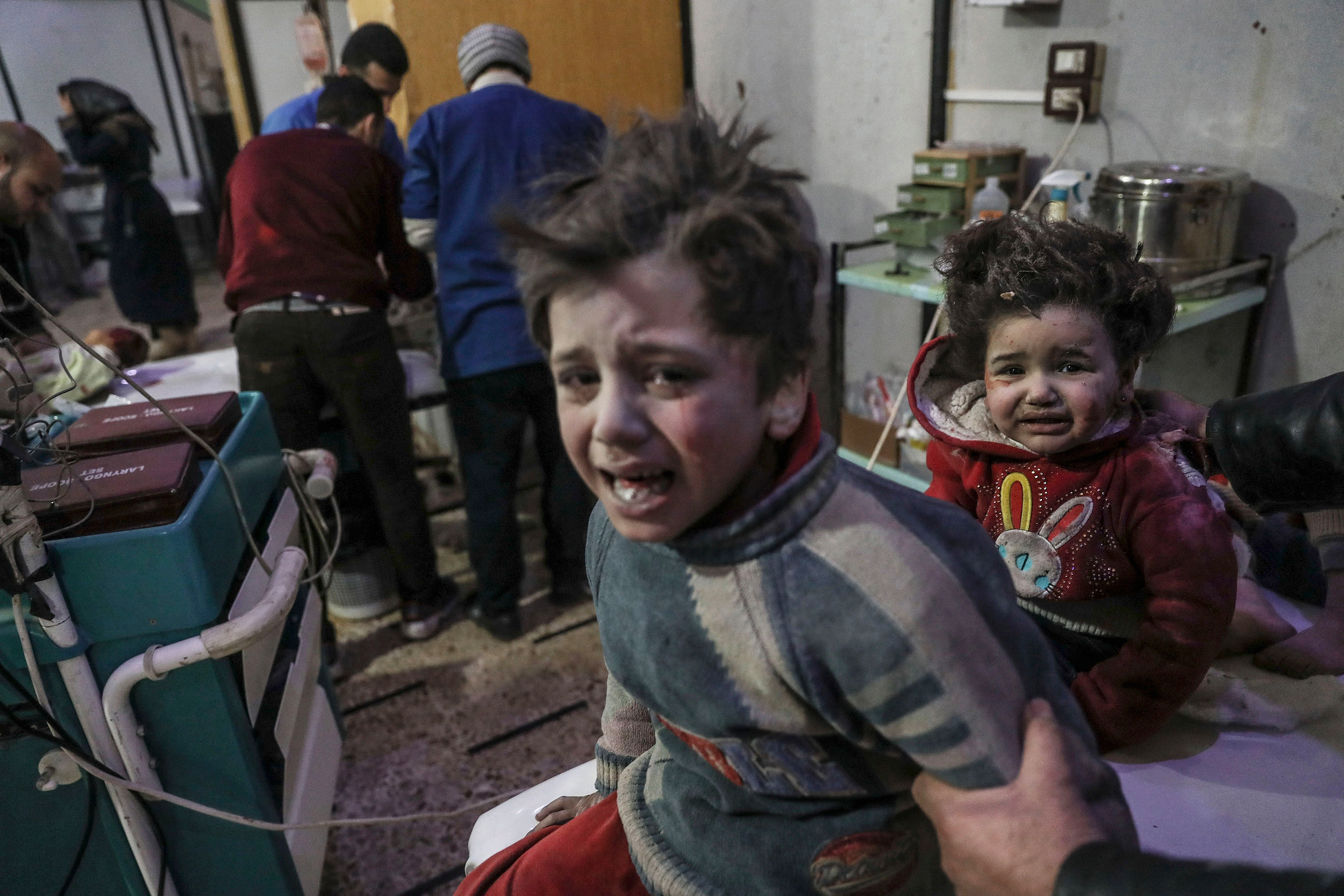 Injured children are treated at a hospital in Douma, a city in the Damascus district of eastern Ghouta, on Feb. 19