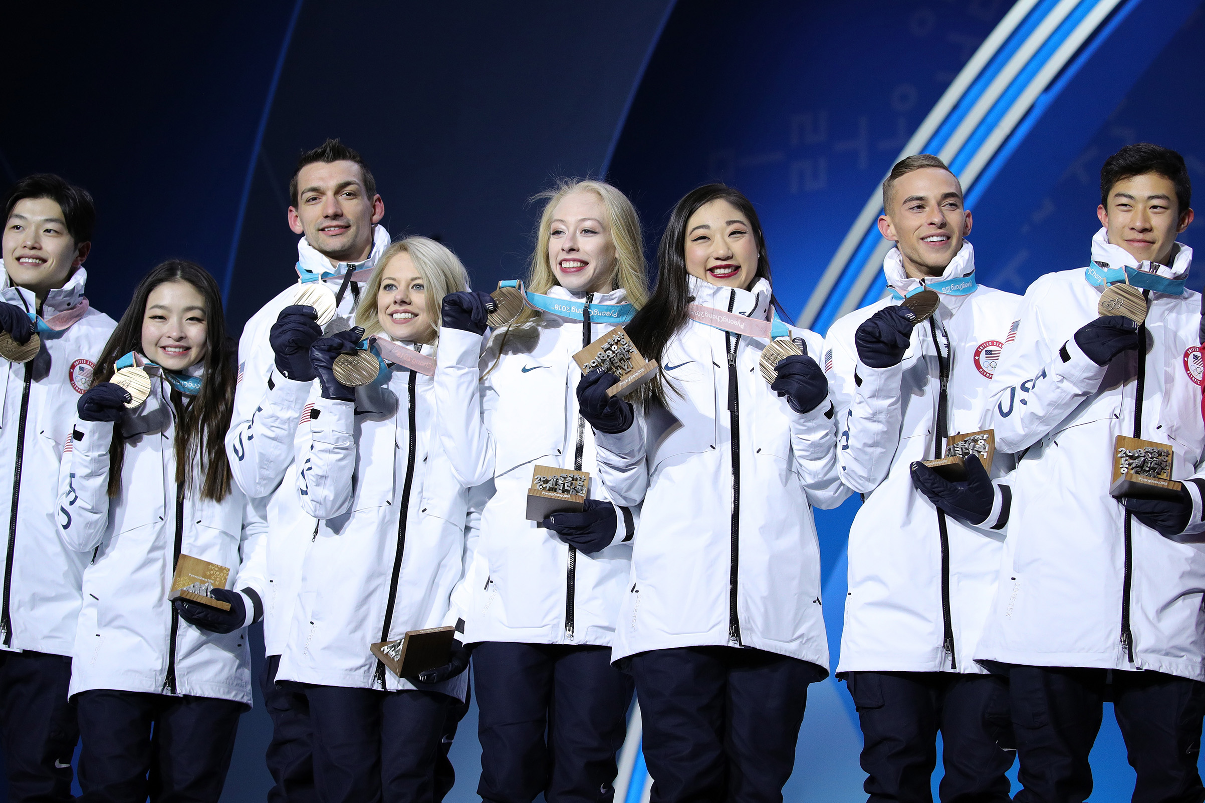 Bronze medalists Alex Shibutani, Maia Shibutani, Chris Knierim, Alexa Scimeca Knierim, Bradie Tennell, Mirai Nagasu, Adam Rippon and Nathan Chen of Team United States celebrate during the victory ceremony after the Figure Skating Team Event on Feb. 12, 2018.