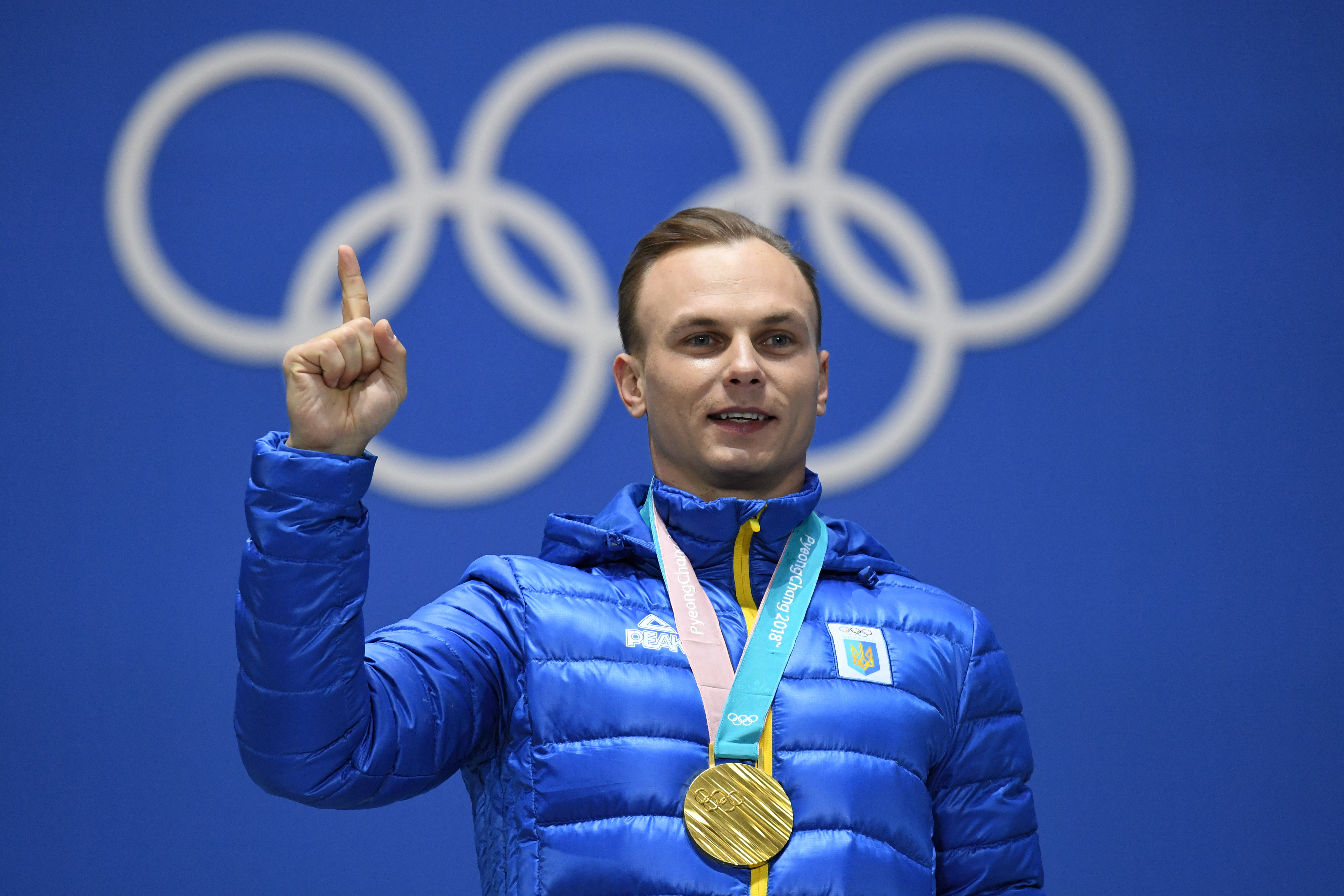 Ukraine's gold medallist Oleksandr Abramenko gestures on the podium during the medal ceremony for the freestyle skiing Men's Aerials