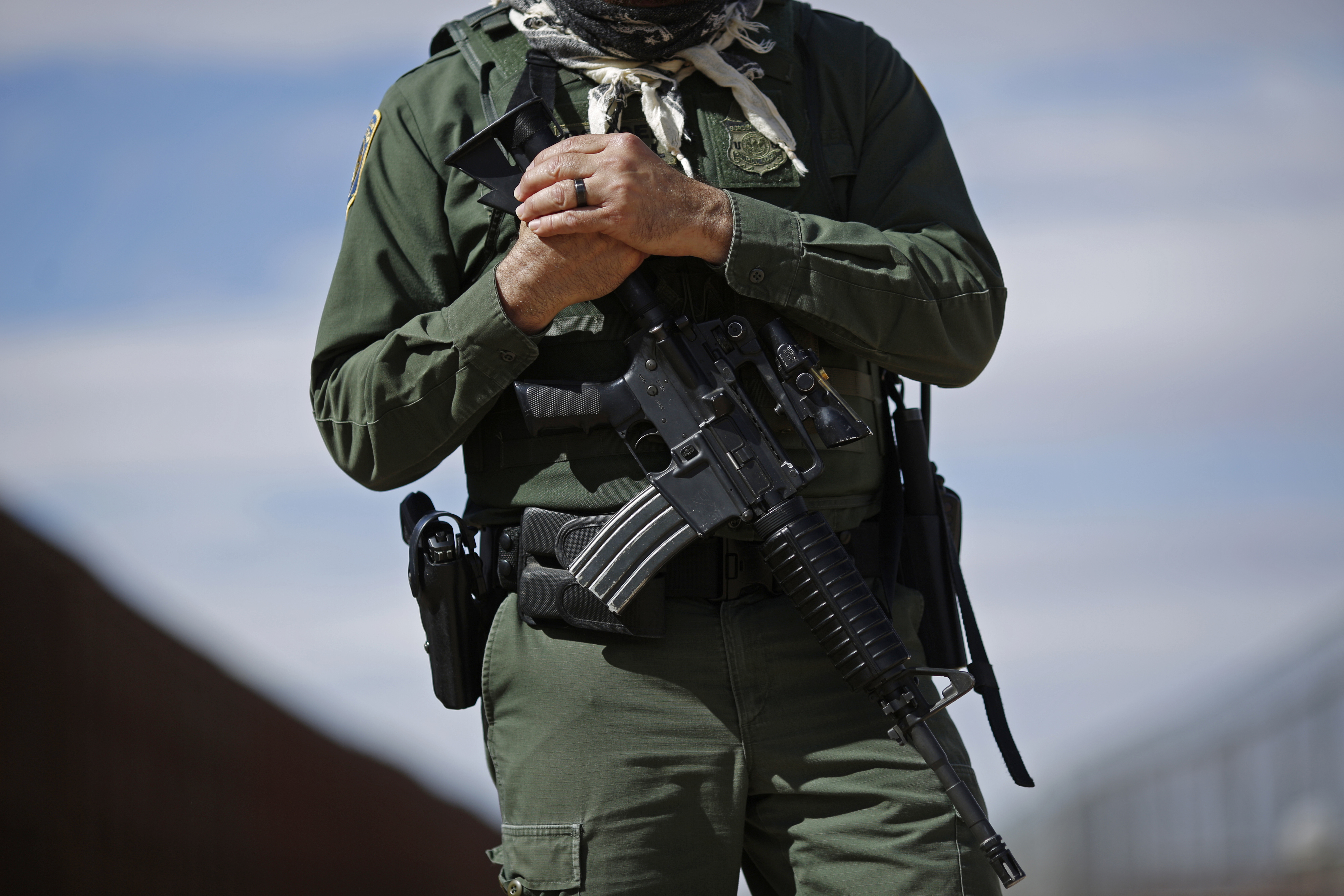 A U.S. Border Patrol agent stands for a photograph while keeping watch along the U.S. and Mexico border in Santa Teresa, New Mexico, U.S., on Friday, Feb. 17, 2017. Photographer: Luke Sharrett/Bloomberg via Getty Images