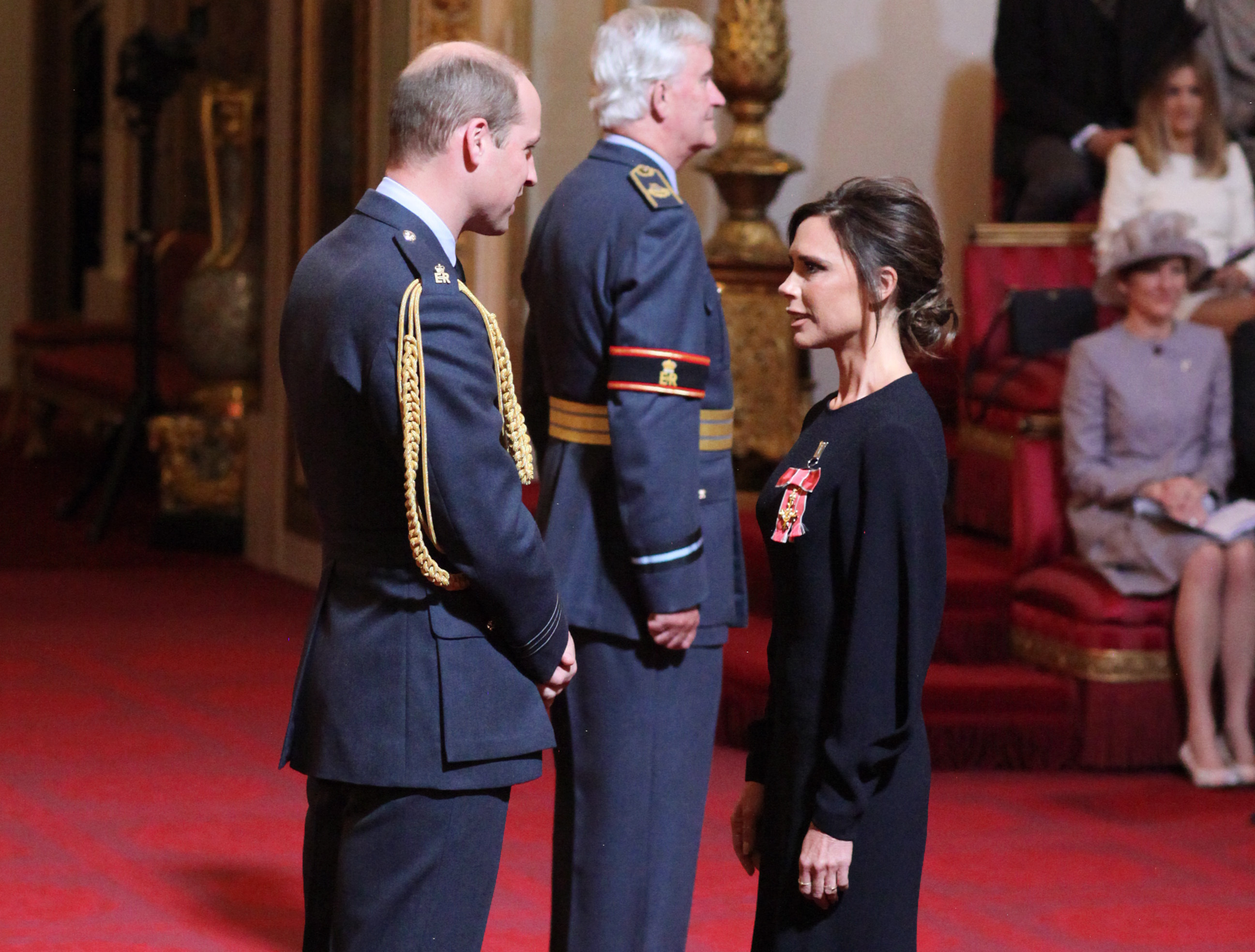 Victoria Beckham receives her OBE from the Duke of Cambridge during an investiture ceremony at Buckingham Palace in London.