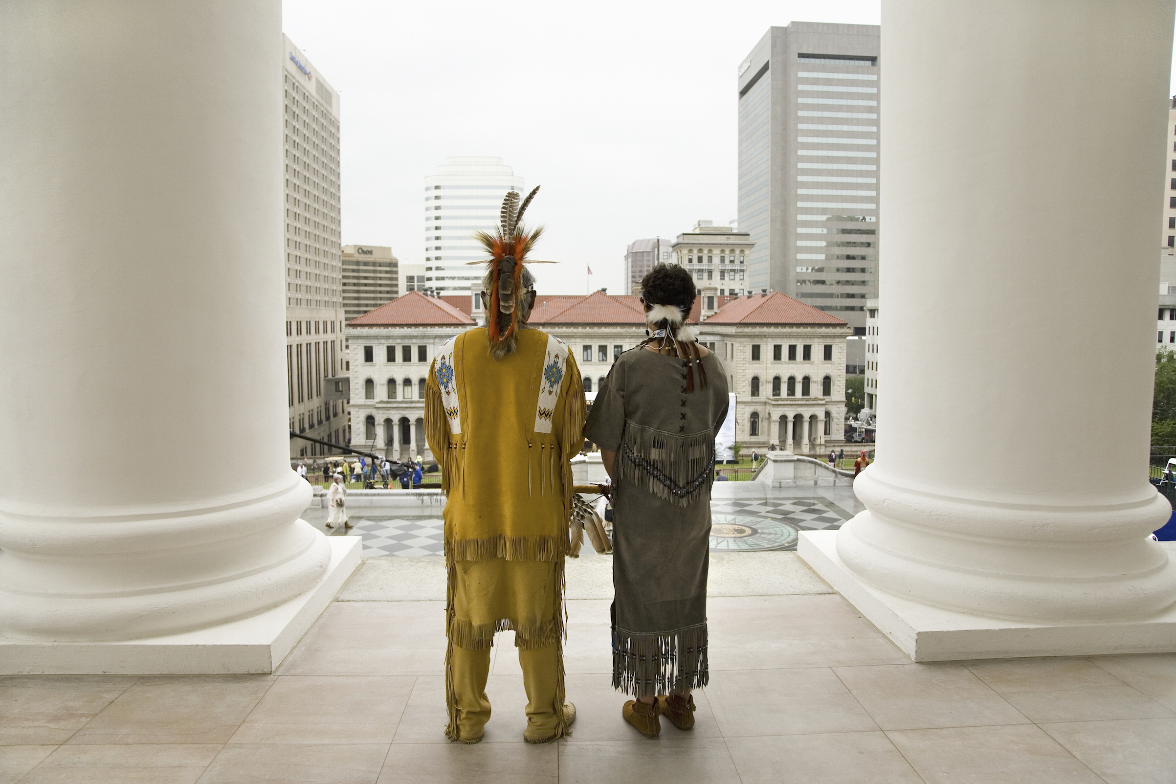 Two Powhatan Tribal members looking over Richmond, Va., from the State Capitol during ceremonies for the 400th Anniversary of the Jamestown Settlement on May 3, 2007.