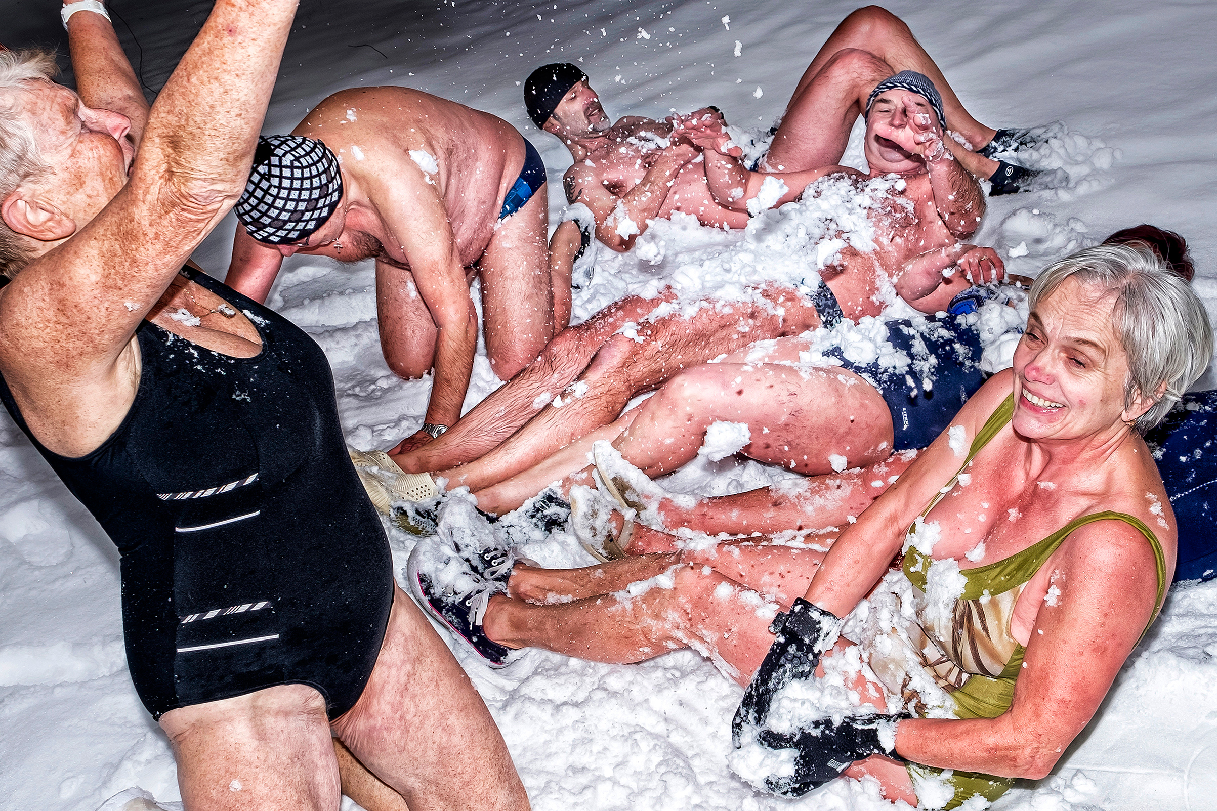 Ice swimmers often finish their meet-ups by rolling in the snow—then warming up together by a stove